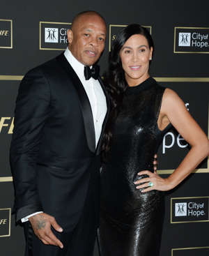 Dr. Dre et al. posing for the camera: Dr. Dre, ex wife Nicole Young