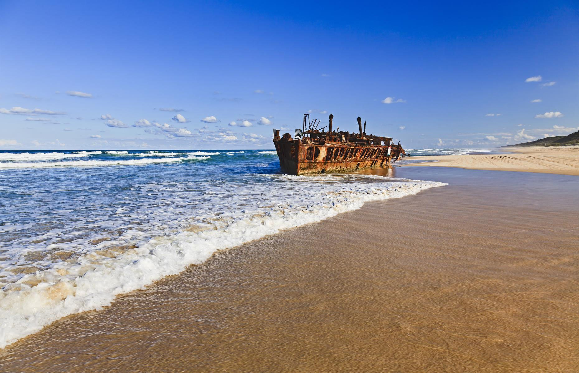 Slide 18 of 33: Australia's Fraser Island is no stranger to shipwrecks – 23 wrecks were recorded in its waters between 1856 and 1935 when SS Maheno crashed ashore. The mighty steamship, which was built in 1905, was one of the first turbine-driven steamers. It plied a regular route between Sydney and Auckland before being used as a hospital ship during the First World War. It was decommissioned in 1935 and was being towed to Japanese shipwreckers when a cyclone snapped the tow chain and left the vessel drifting.