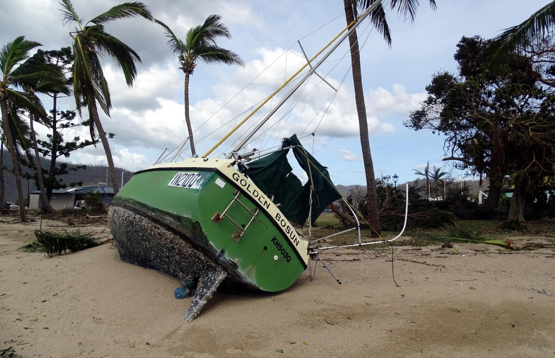 Slide 25 of 33: Cyclone Debbie caused damage to property, unleashing boats from their moorings and smashing them on rocks before they were washed ashore. Huge trees and door frames were also lifted and flung across beaches in the intense winds.