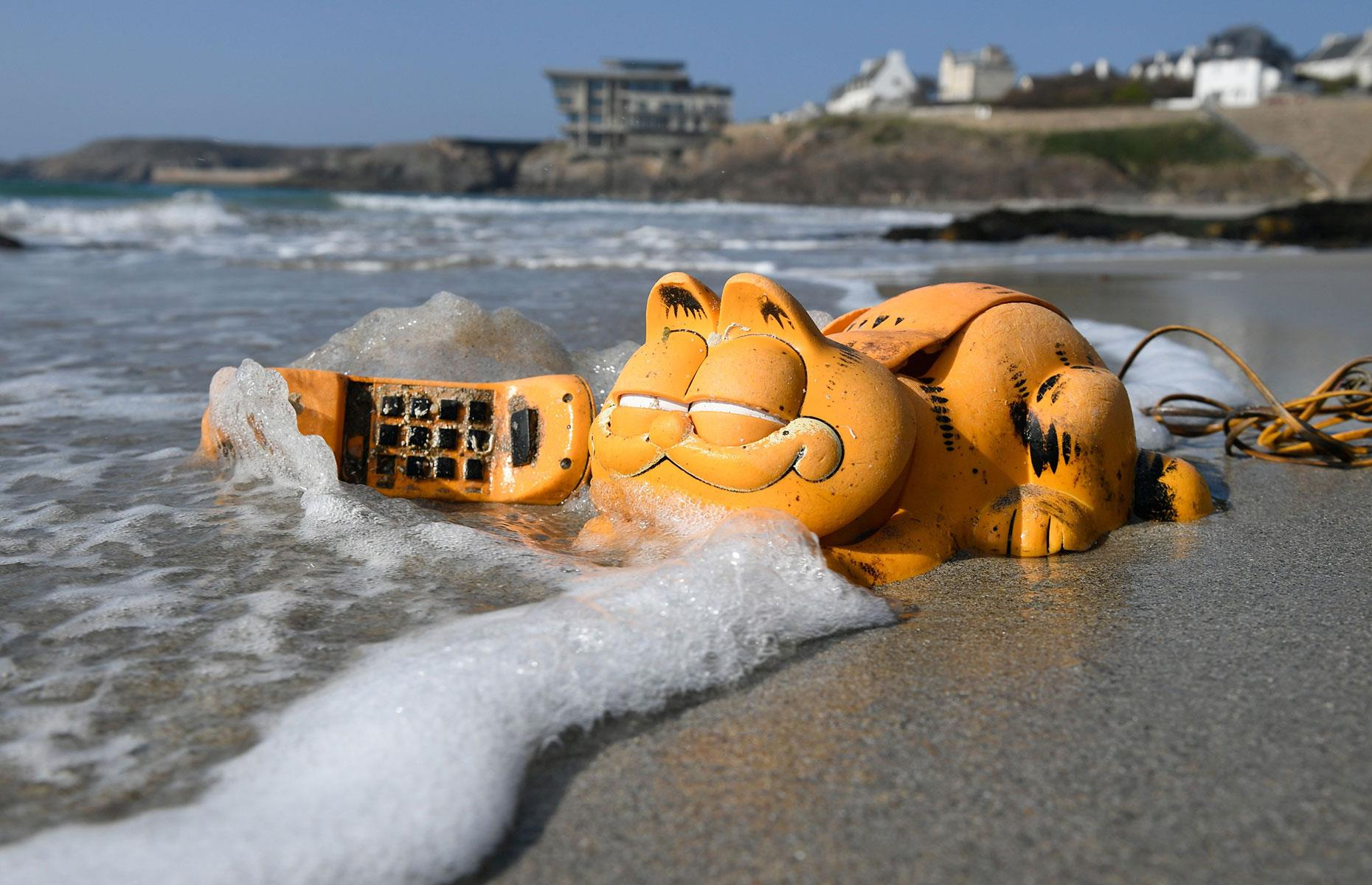 Slide 33 of 33: During the 1980s novelty plastic phones in the shape of the infamous lasagna-eating cartoon cat Garfield began appearing on beaches in Brittany. The mystery wasn't solved until March 2019, however, when a shipping container filled with the devices – washed up during a storm some 30 years before – was found in a sea cave.