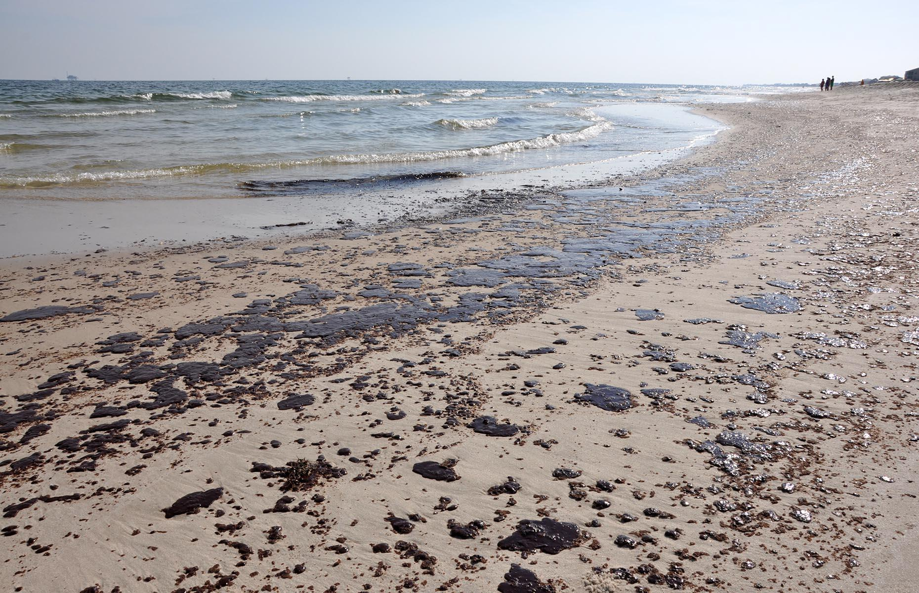 Slide 11 of 33: There's no doubting the damage done by an oil spillage impacts both the environment and communities for many years after the event. Pictured here are tar balls – clumps of sticky oil, sand and shells – at Gulf Shores, Alabama in 2010, shortly after the Deepwater Horizon oil spillage. However, two years later, Hurricane Isaac wreaked havoc in the southern states and the tar balls returned along Alabama and Louisiana's coastline, including Elmer's Island.