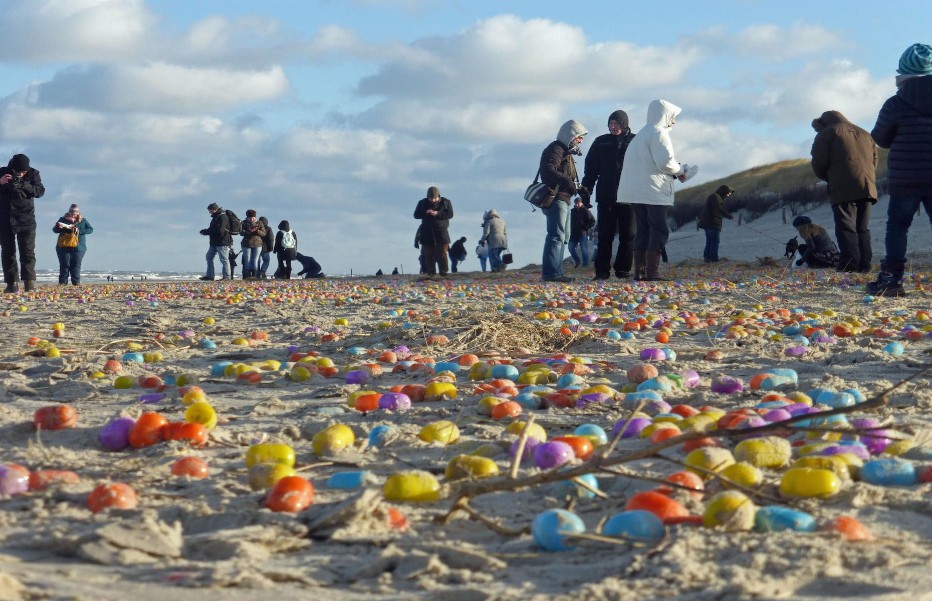 Slide 4 of 33: Children on Germany's North Sea island Langeoog thought the Easter bunny had come early in January 2017 as thousands of colorful plastic eggs floated onto its sandy beaches. The eggs, which contained little toys, had washed ashore from a Danish freight container that had lost its contents in stormy weather. Locals, including children and tourists, congregated to help with the clear up.