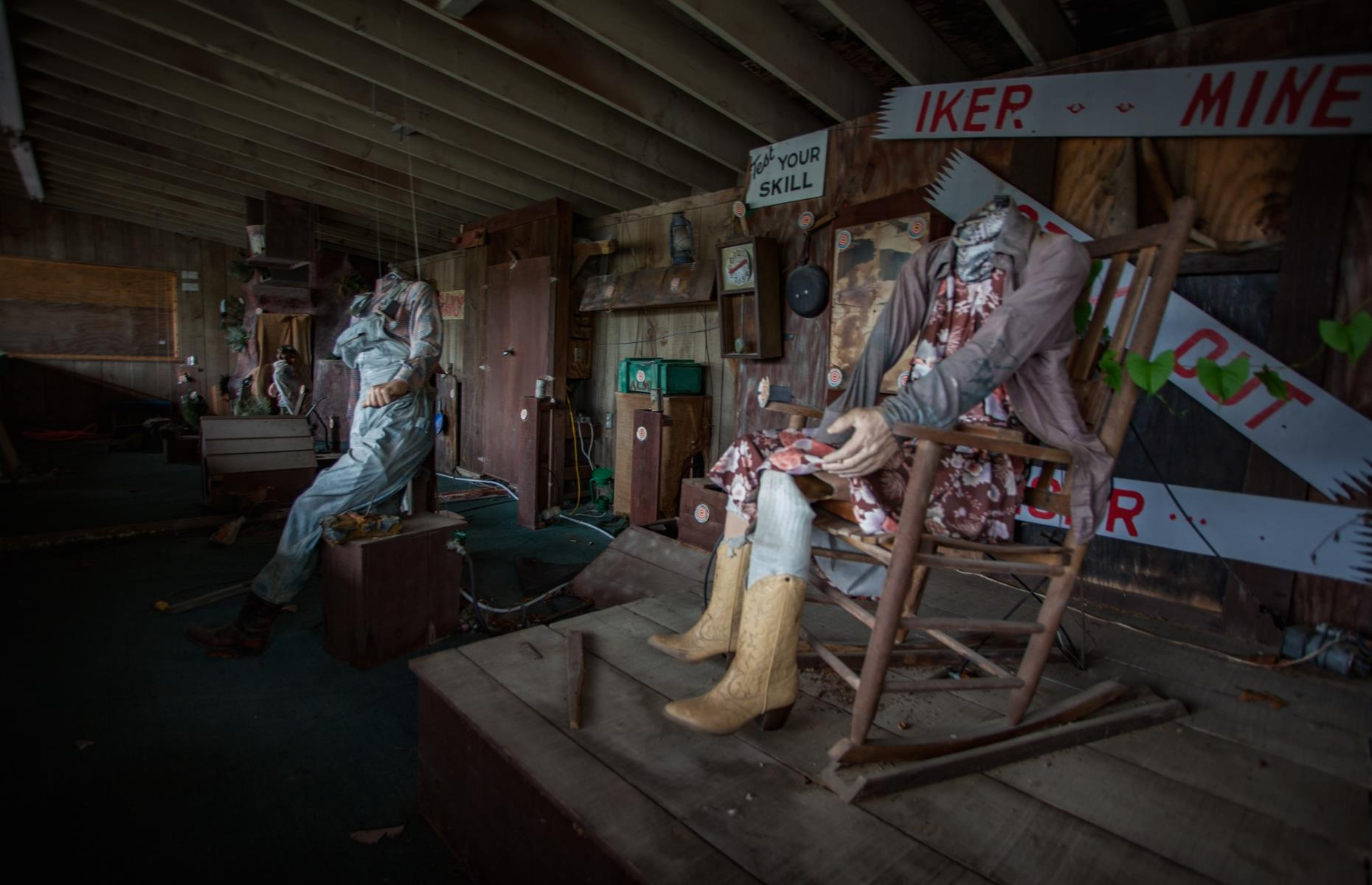 Slide 20 of 28: In true cowboy fashion, Heritage Town Square also had a mining-themed shooting gallery. Pictured are sinister headless mannequins decked in Western-style clothing, some of the spooky remains of the abandoned area.
