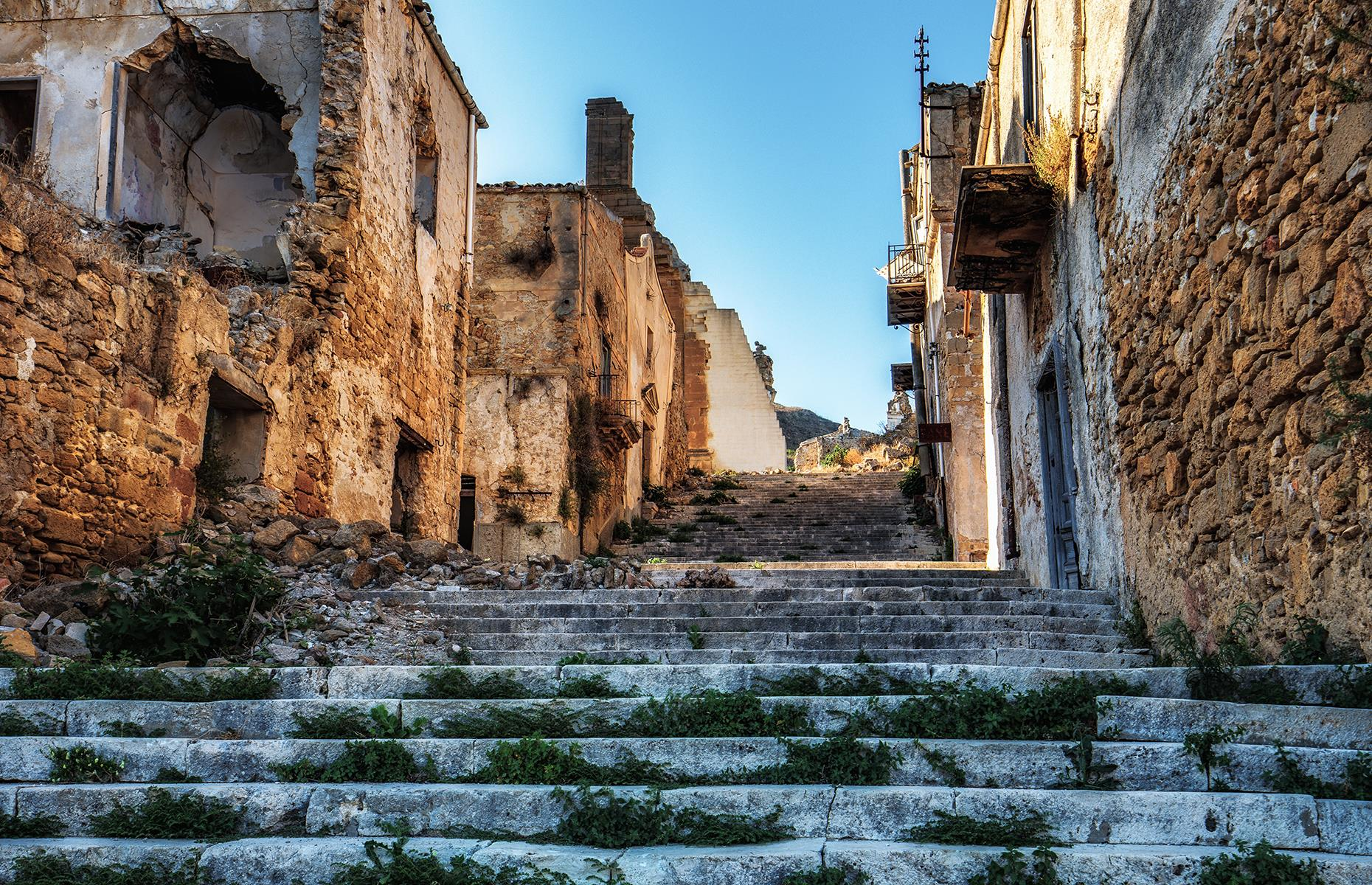 Slide 52 of 68: When a violent earthquake rocked Poggioreale in Sicily in January 1968, the devastated town was abruptly abandoned. The survivors rebuilt their community across the valley.