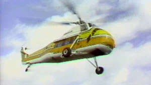 "a plane flying in the air: 1977: Let's Slap an 8-Track in the Player and Fly, Fly Away  It's hard to imagine a crazier mismatch than the energy-challenged 1970s and a gas-guzzling, flying camper, but Winnebago's Heli-Home (aka the Heli-Camper) was a real thing forty years ago.  Ads touted it as ""the most dramatic, comfortable, convenient and unique RV in the world."" The Heli-Home had room for six passengers and packed a complete, if tiny, kitchen and living space into its 115 square feet. Entertaining aloft was a must -- the Heli-Home was equipped with a TV, a mini-bar, and an eight-track tape deck.   This was the 1970s, after all.  Fewer than ten Heli-Homes were sold. Maybe its hefty price tag ($185,000 and up) and its greedy gas mileage -- 75 gallons an hour -- had something to do with that. But the contraption attracted a lot of attention at RV shows and dealerships and it got attention from TV news crews, as demonstrated by this WTVJ news clip from 1977.  Subscribe to the Lynn and Louis Wolfson II Florida Moving Image Archives' YouTube channel and tune in to the fascination and fun of Miami and Florida's past, captured on film and video and preserved by the Wolfson Archives at Miami Dade College.  This video and audio is copyrighted/owned by the Lynn and Louis Wolfson II Florida Moving Image Archives at Miami Dade College."