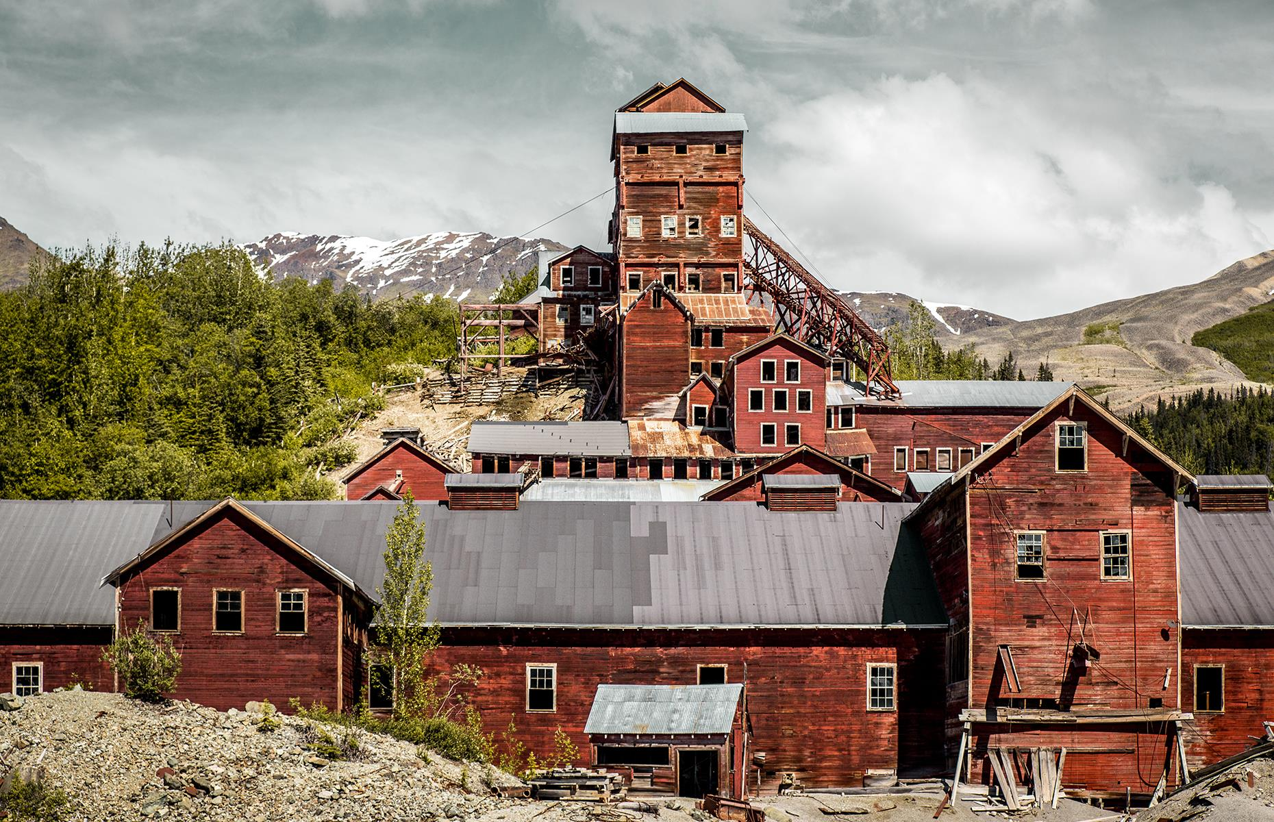 Slide 65 of 68: Located about 6.5 miles (10km) east of the Kennicott Glacier, Kennecott was a mining camp, central to several copper mines. The town was built in 1911 and by 1916 the mines produced copper ore valued at $32.4 million. However, the high-grade ore started to run out in the late 1920s and the first mine closed in 1929 with the rest following the same fate. The last train departed from Kennecott on 10 November 1938, leaving it abandoned.