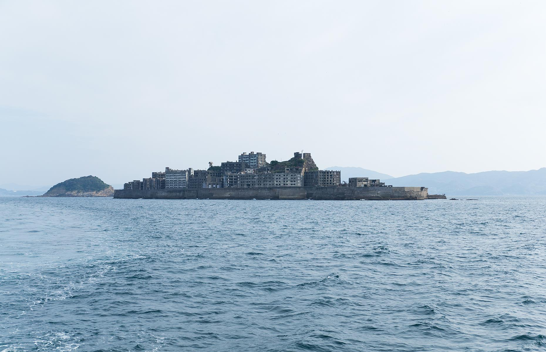 Slide 36 of 68: This tiny island, commonly called Gunkanjima, just off the coast of Nagasaki, was once the site of an undersea coal mine. So rich were the coal resources that by the 1950s some 6,000 miners were squeezed ashore, housed in 10-story high rises. It's also known as Battleship Island because of its shape.