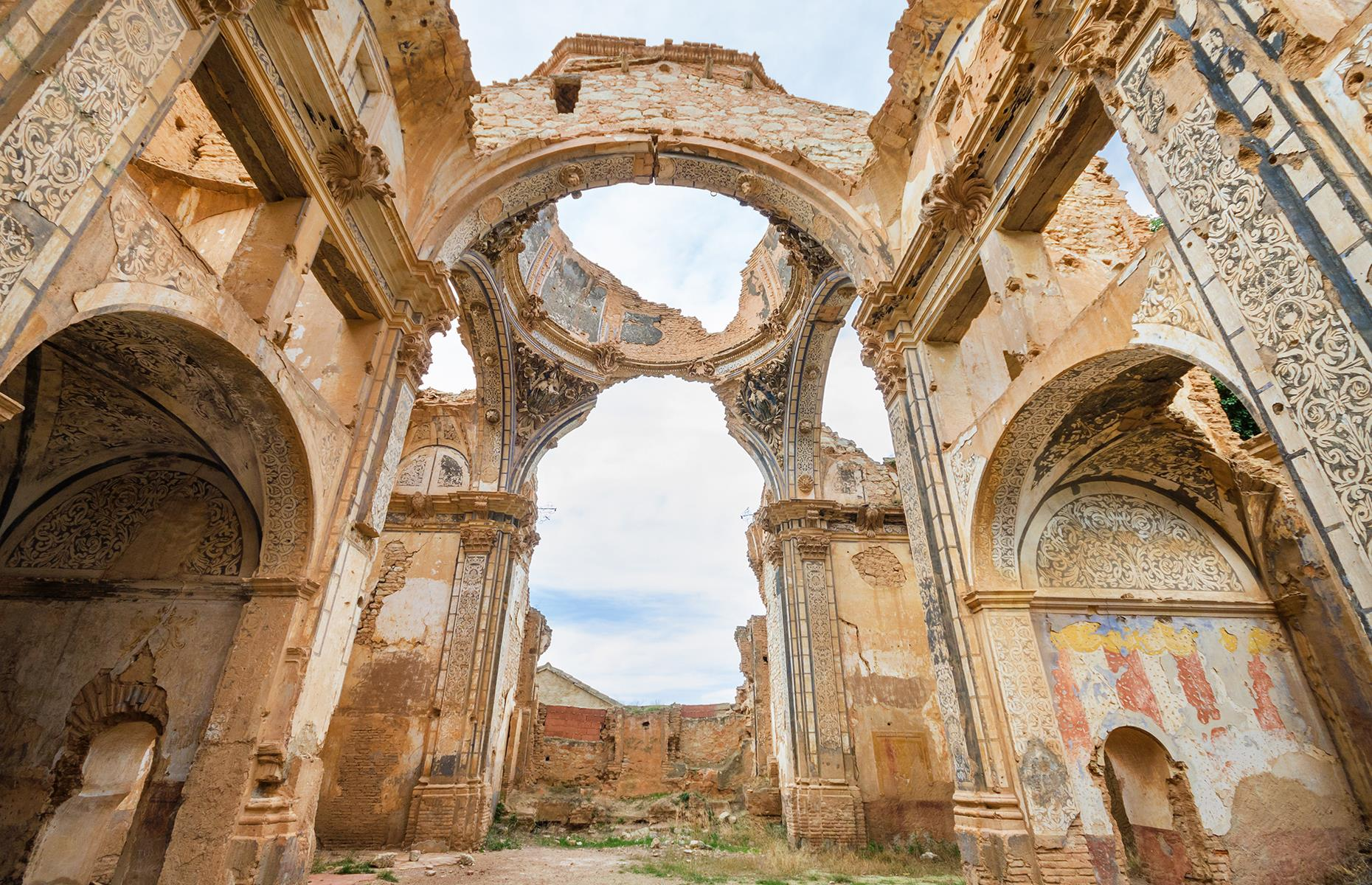 Slide 20 of 68: Located near Zaragoza in the northeast of Spain, Belchite was almost completely destroyed 80 years ago during one of the bloodiest battles of the Spanish Civil War. After the war, it was decided the town should be left untouched and abandoned as a memorial to the 3,000 people who were killed there.