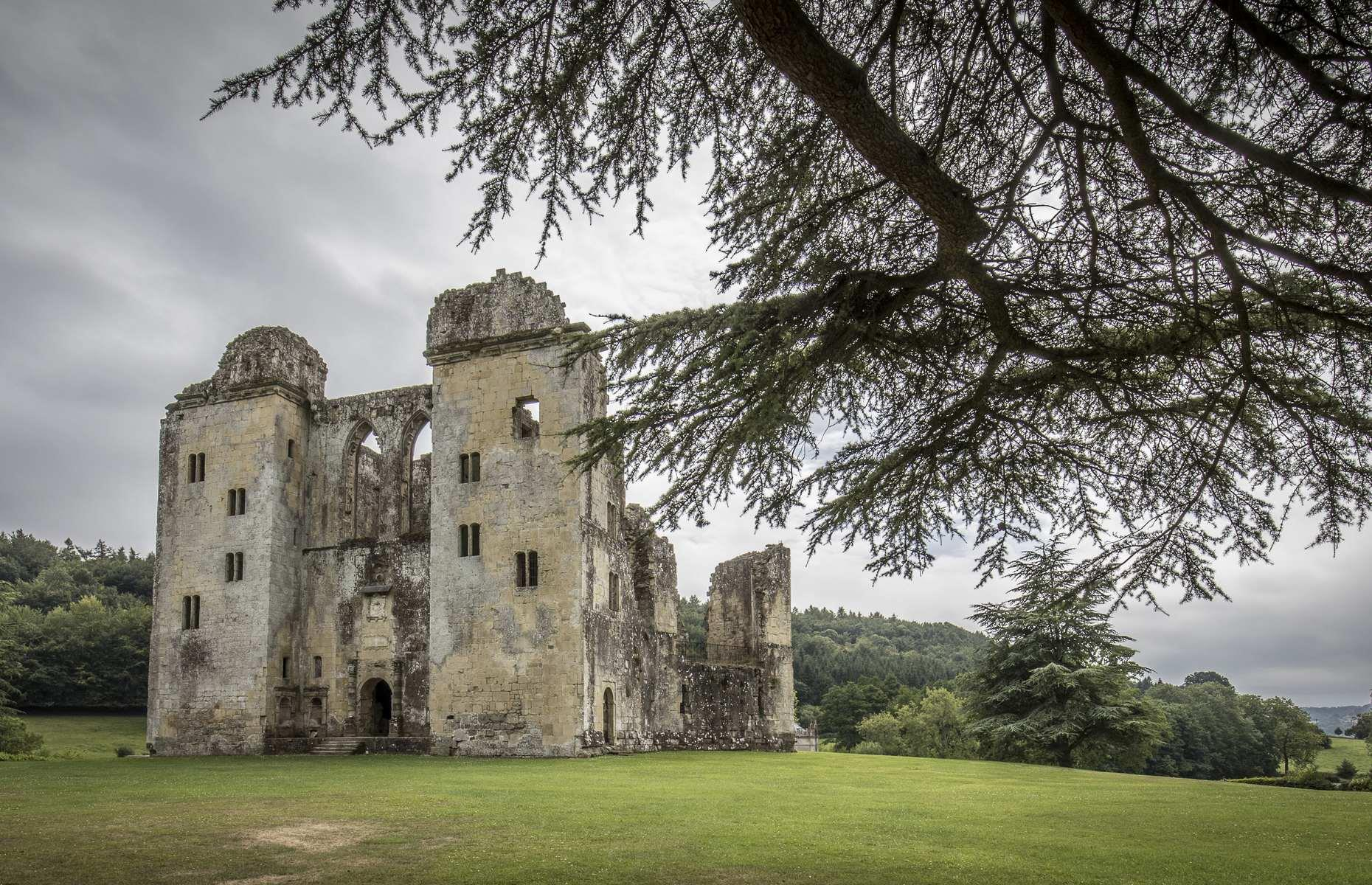 Slide 13 of 29: So deeply rooted is Old Wardour Castle in the English countryside that it seems to have always been in this crumbling state. But in the 14th century, here stood a magnificent French-style castle, built by John Lovell after marrying heiress Maud Holland.