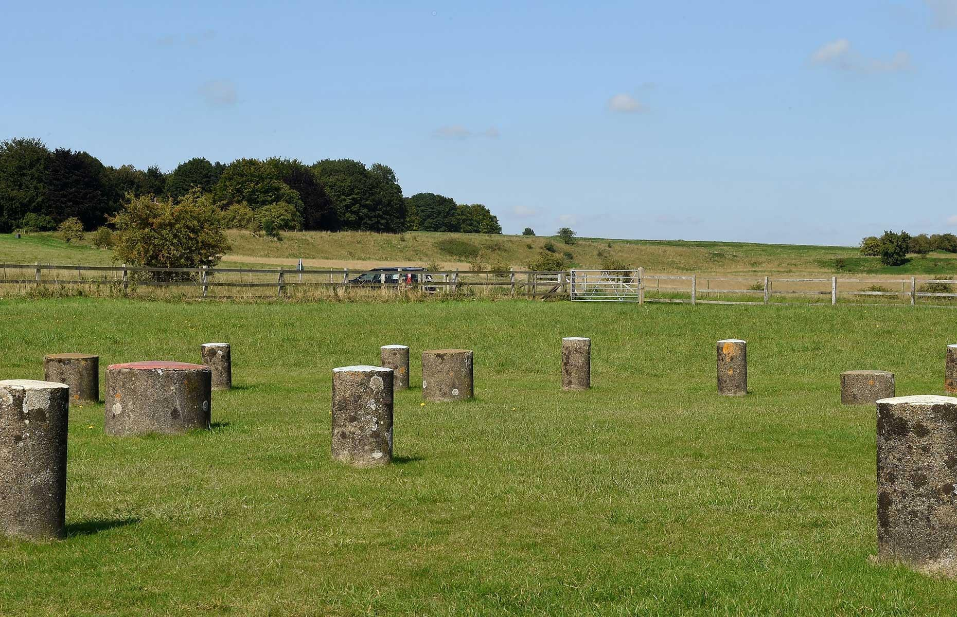 Slide 4 of 31: A circle of vast prehistoric shafts has been discovered just under two miles (3.2km) from Stonehenge. The 20 shafts – more than 33 feet (10m) in diameter and 16.4 feet (5m) deep – seem to have been designed to create a circle around Durrington Walls henge (pictured here) and Woodhenge, another smaller prehistoric circle to the south. Radiocarbon dating revealed the shafts are 4,500 years old and from the Neolithic period. It's likely the same people who constructed Stonehenge built the shafts at Durrington Walls, now the largest prehistoric site discovered to date in the UK.