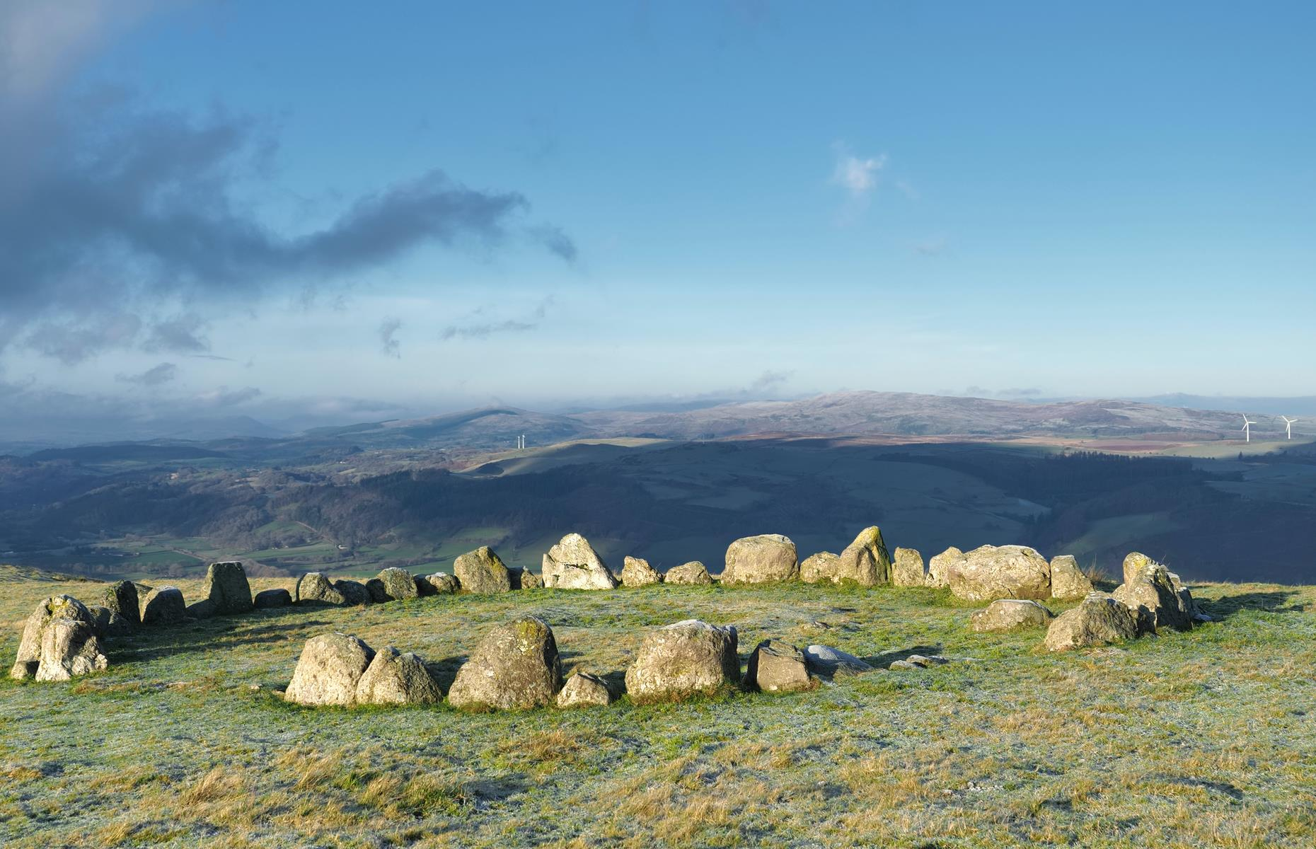 Slide 12 of 31: It might be small, but this almost perfect circle of ancient stones huddled high in the hills above the Dee Valley is something special. Its remote setting only adds to the palpable sense of history here. The Ring of Tyfos stone circle and Caer Drewyn Hillfort are close by too.