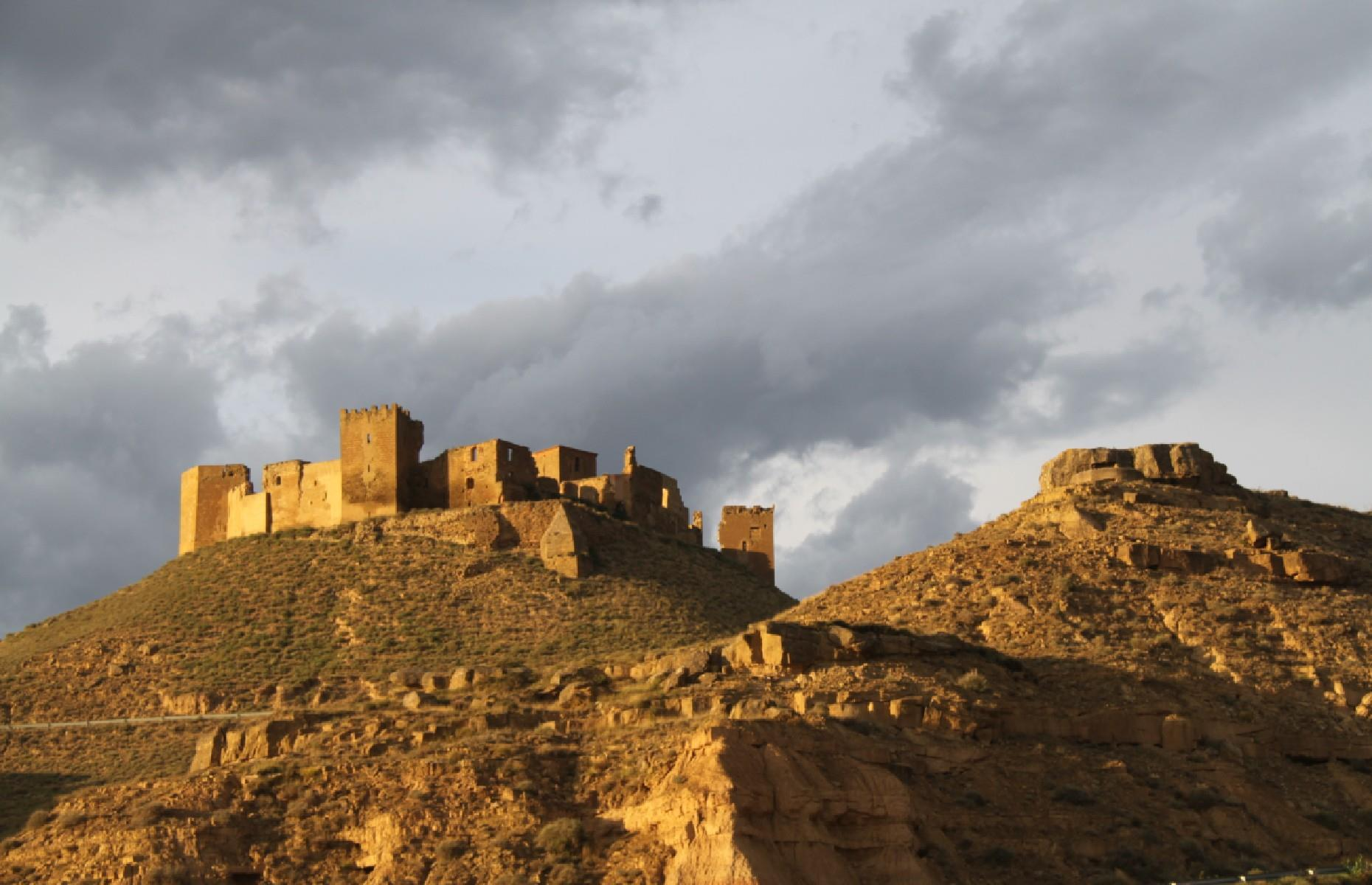 Slide 18 of 29: This 11th-century castle is visible for miles on its high vantage point overlooking the plains of Huesca, in Aragon, northern Spain. It was originally built to help conquer the then-Muslim area of Huesca but later was given over to Augustine monks who used it for seven centuries.