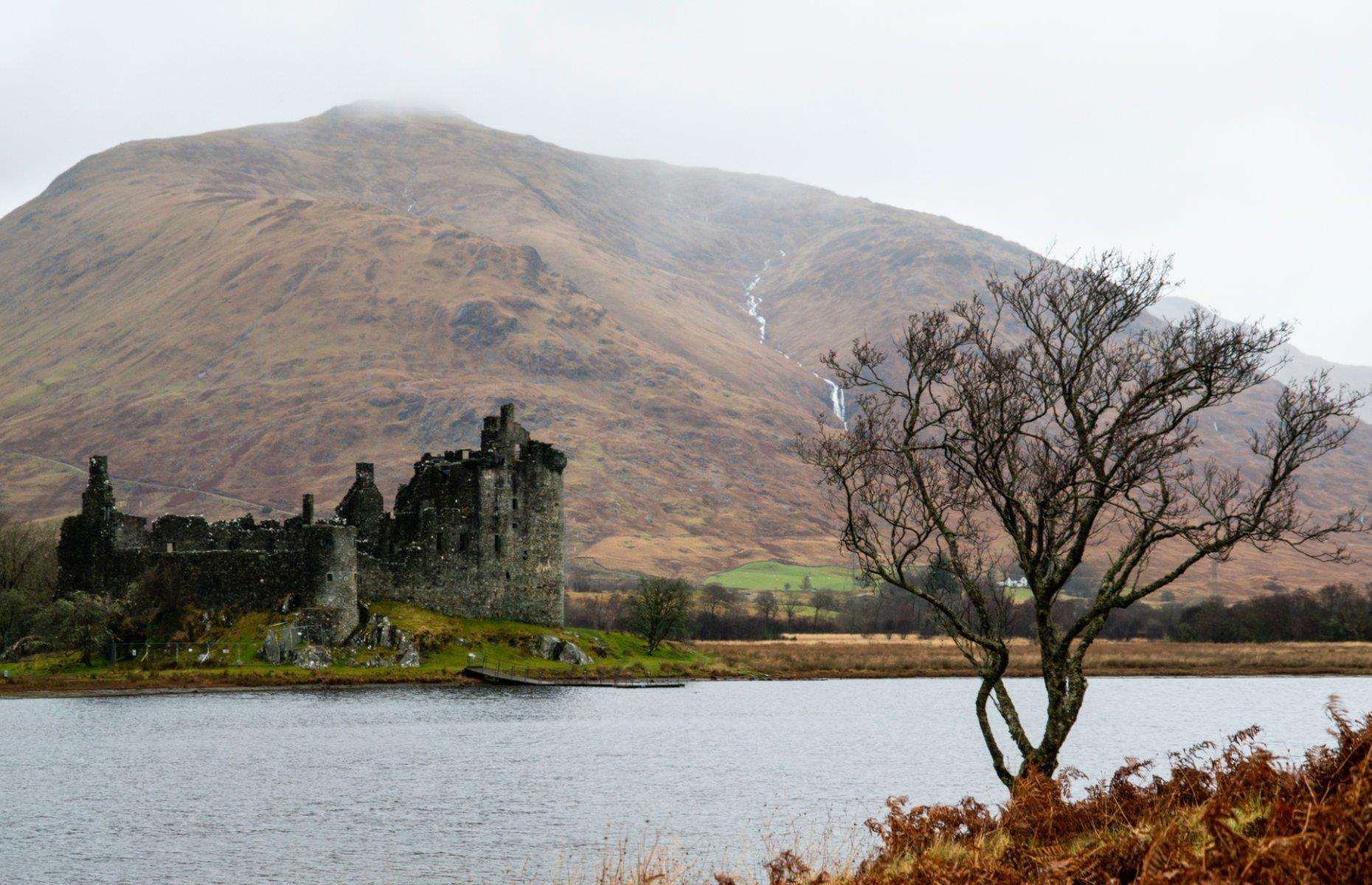 Slide 24 of 29: Back in the 13th century, Kilchurn Castle was a hub of energy. It was built in the mid-1400s by the Campbells of Glenorchy, a family who dominated the central Highlands. Originally it was constructed on an island not much bigger than the castle itself and was accessed by a causeway. During the Jacobite uprising of the late 1600s, the castle was converted into a garrison stronghold and at one time could hold 200 troops.