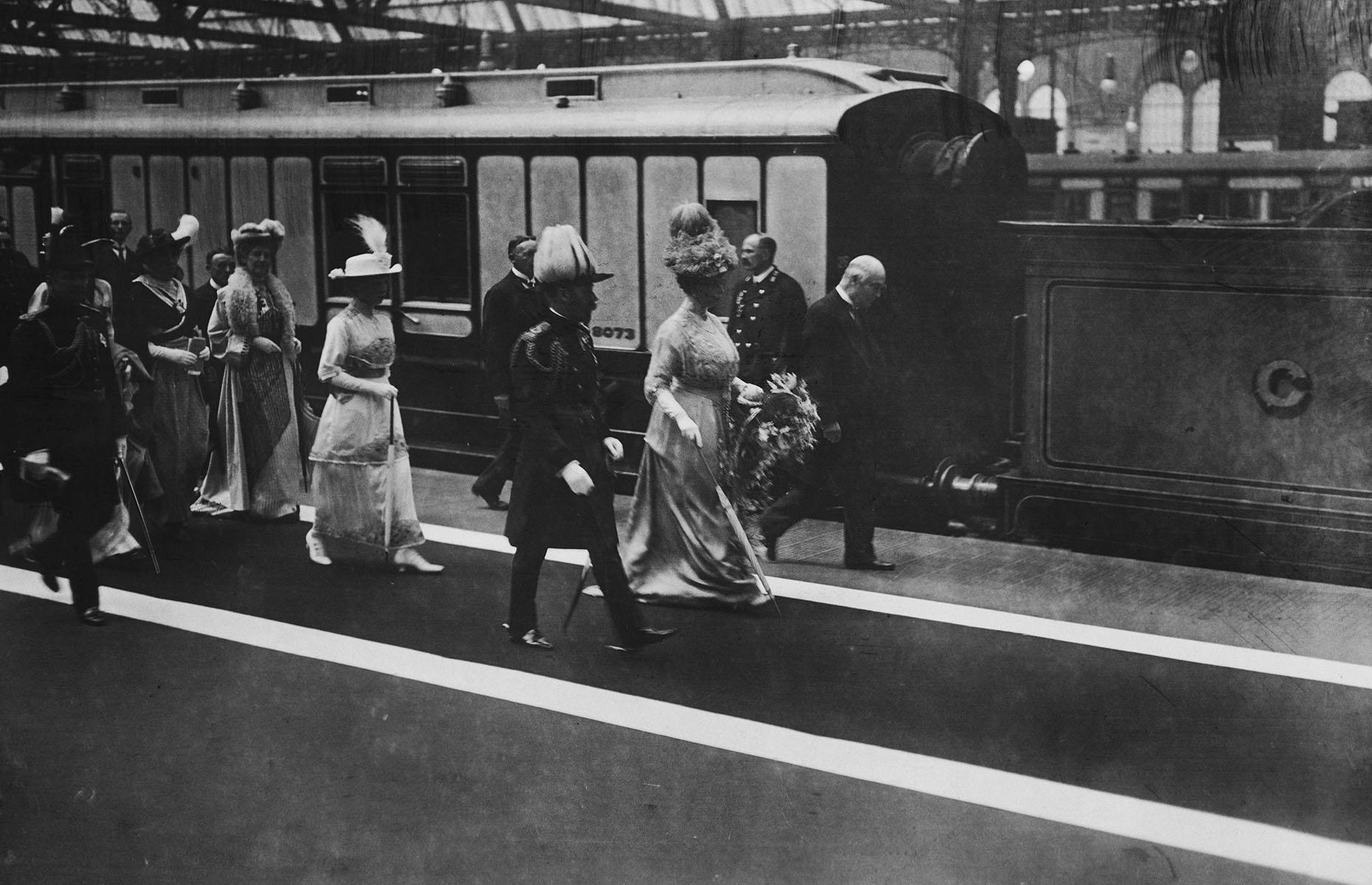 Slide 9 of 32: For many years trains were and in some occasions still are the top choice for travel across the UK for the British royals. Here, King George V and the royal party are captured leaving Glasgow Station during a royal tour of Scotland in 1914.
