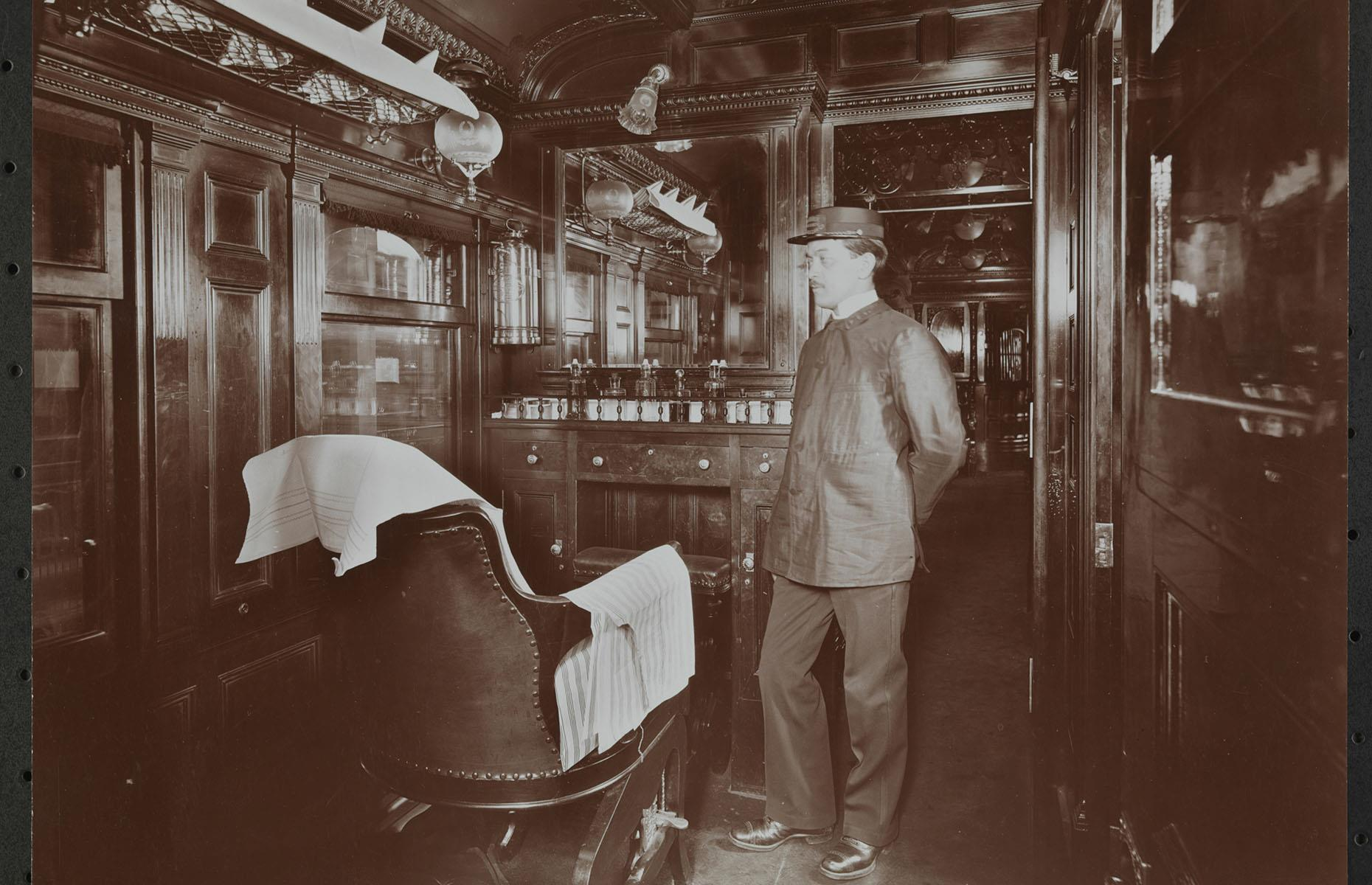 Slide 7 of 32: As the wealthiest passengers' wants and needs grew larger, trains became even more luxurious, turning into 5-star hotels, restaurants and salons on wheels. This barber operated a shop aboard a train of the Erie Railroad, connecting New York City and Jersey City with Cleveland, Buffalo and Chicago.