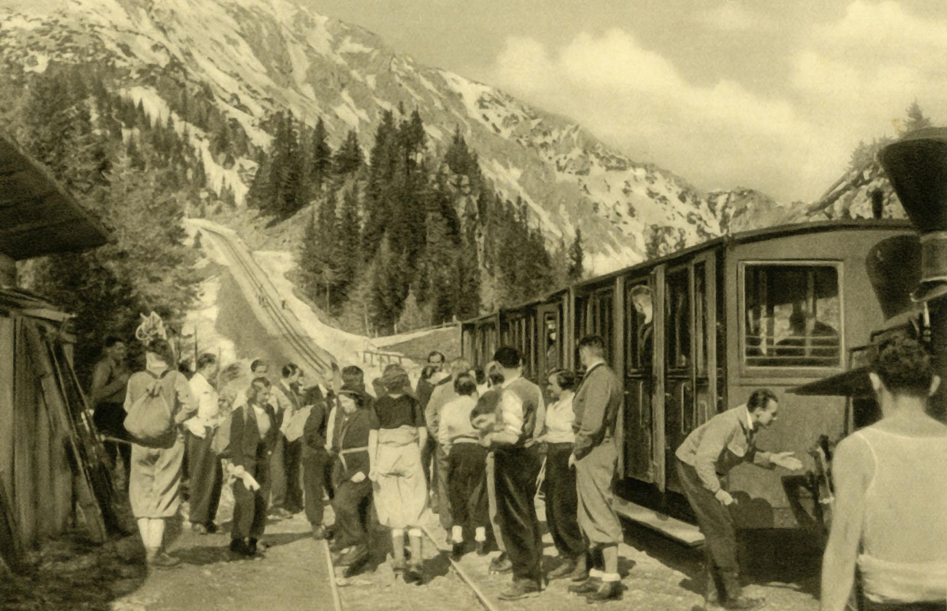 Slide 19 of 32: When tourism skyrocketed in the second half of the 19th century and areas around Vienna became popular with travelers from all across Europe, the mountainous Schneeberg region emerged as a favorite summer resort for the wealthy. Here are a group of hikers disembark the Schneeberg Railway at Baumgartnerhaus Station in 1935.