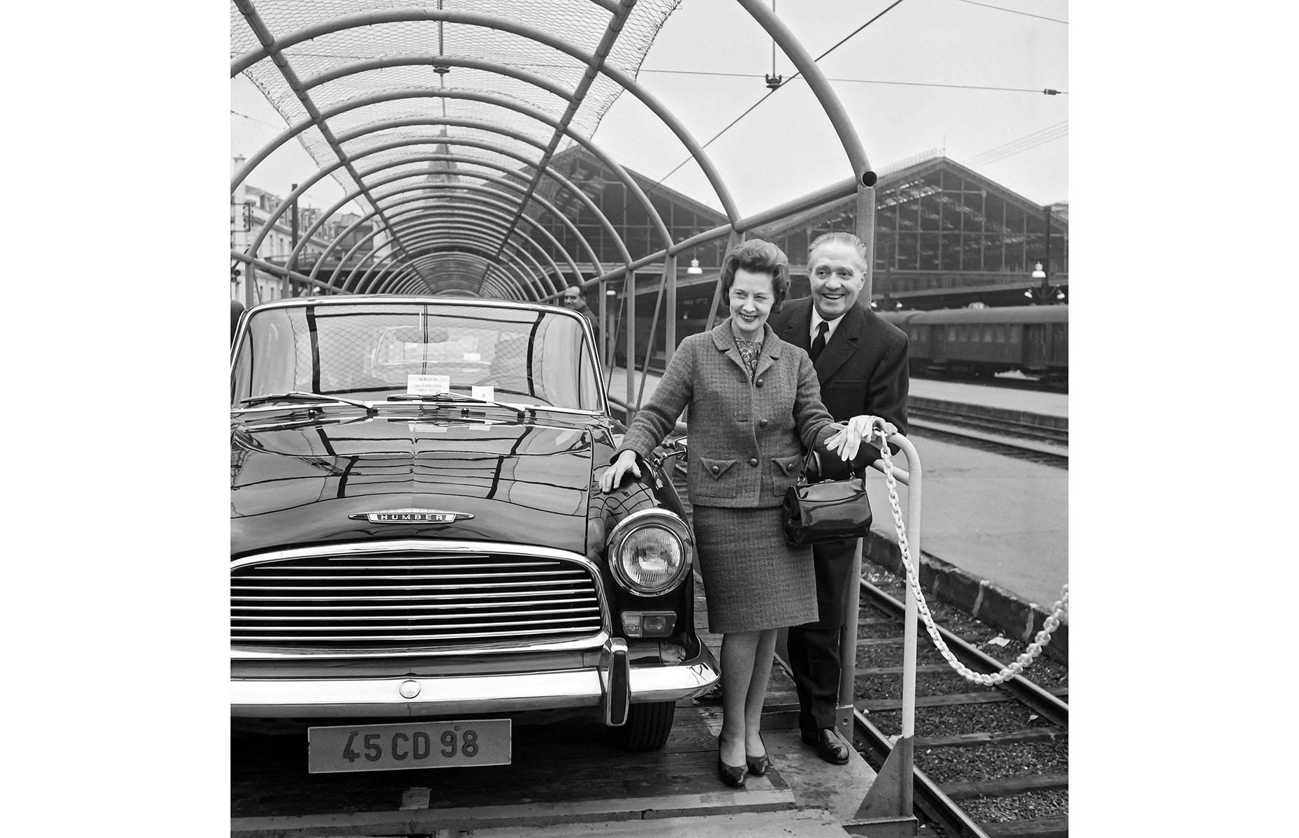 Slide 23 of 32: Although construction on the Channel Tunnel, known as Eurotunnel, didn't begin until 1988, plans to build such a tunnel emerged as early as 1802. Here, British Transport Minister Barbara Castle is photographed with the French SNCF (France's national state-owned railway company) CEO André Segalat on 29 October 1966. They're standing onboard a train-car, showcasing how the transport through the tunnel would work, some 30 years before it actually happened.