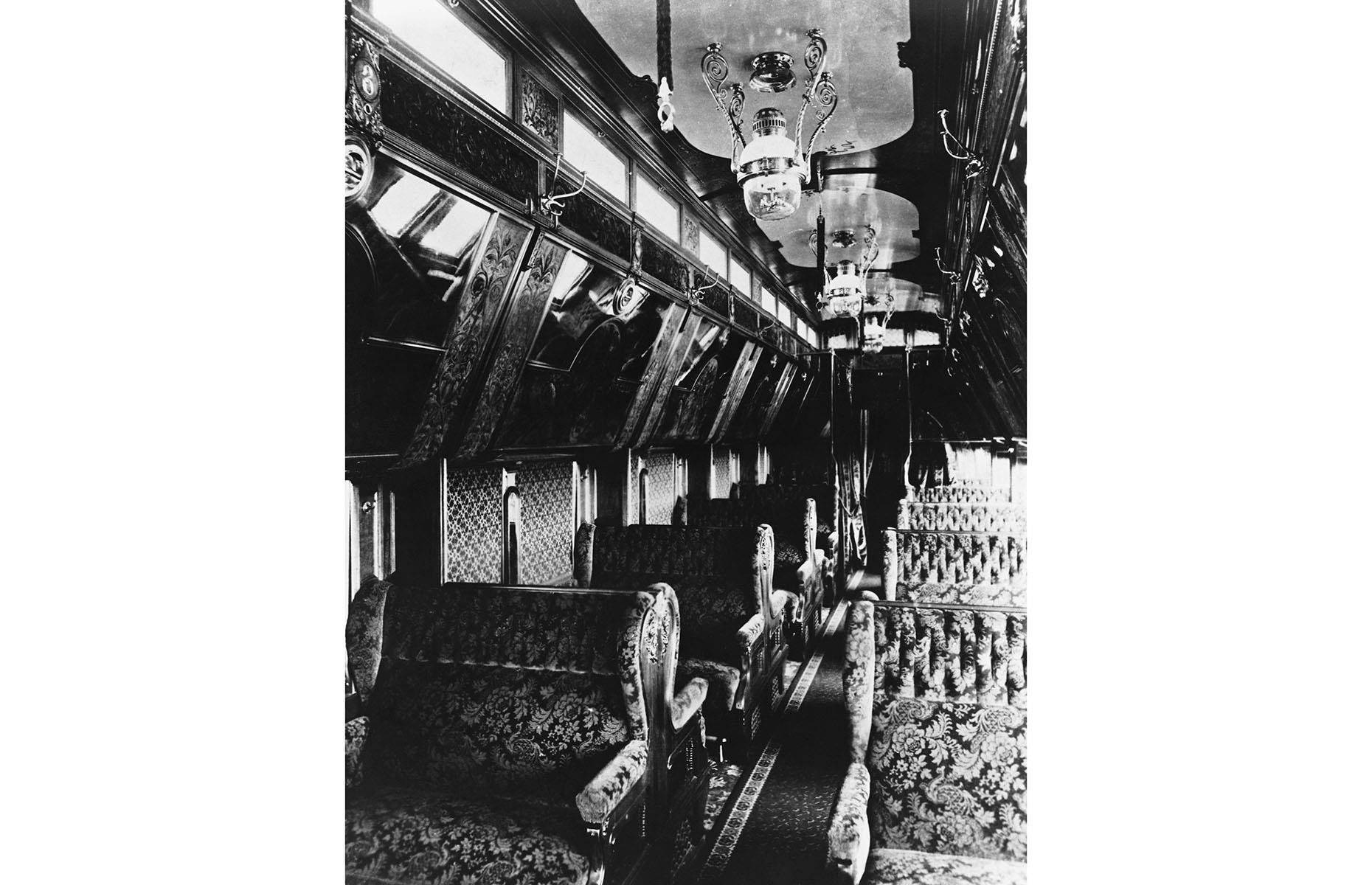 Slide 4 of 32: Before the turn of the 20th century, rail travel was expensive, especially in America, but Chicago-based Pullman Company, led by George Pullman found a way to make it even more luxurious. Founded in 1867, the company produced a range of ornate dining, sleeping and parlor cars and even private cars for the super wealthy. These cars would be attached to commercial passenger trains and were essentially mini mansions on wheels.