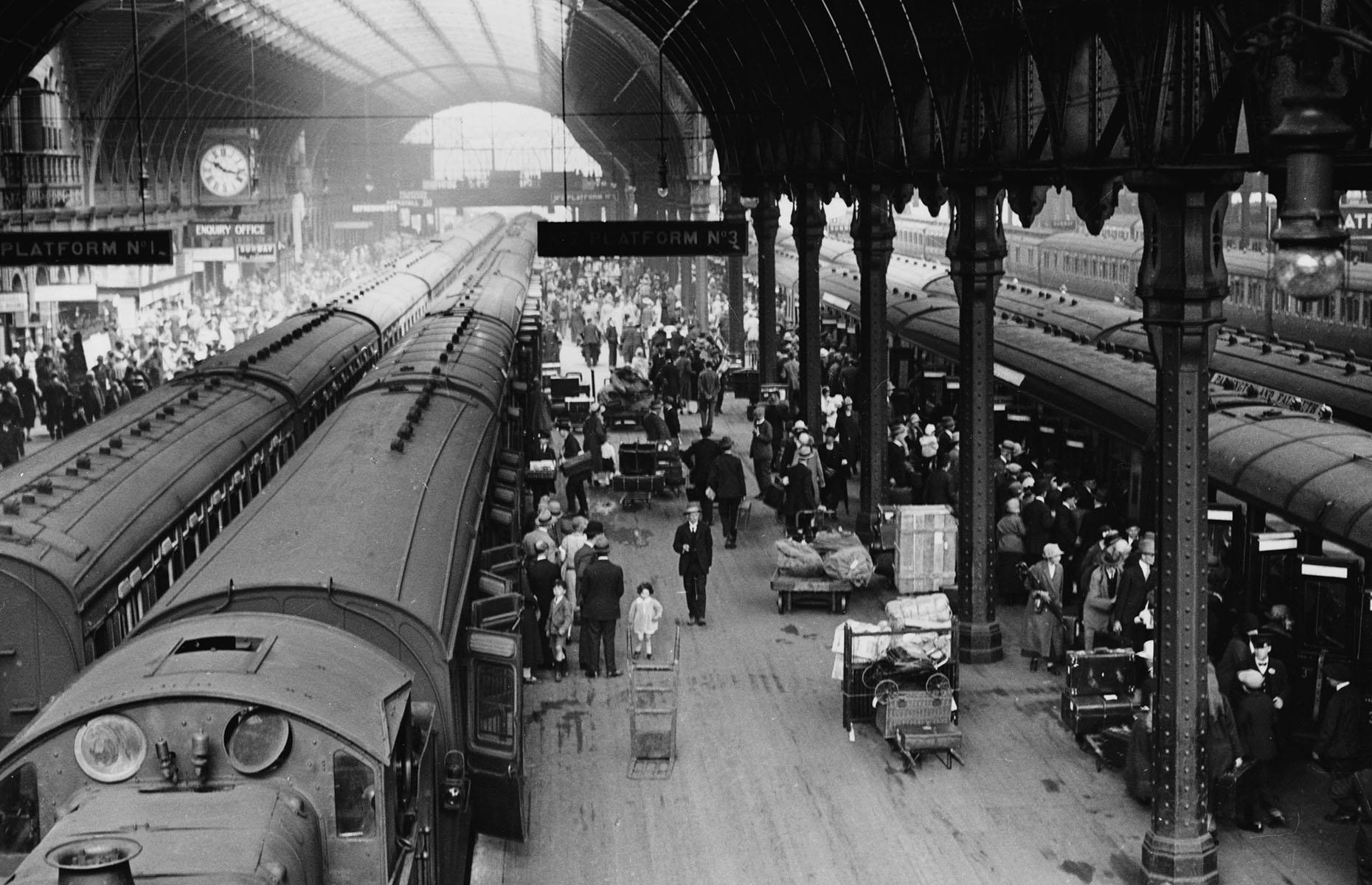 Slide 16 of 32: As summer arrived, Paddington Station in London, England, in June 1926 looked no different to how Stansted Airport does today before vacation season. Crowds are pictured waiting to board trains for Cornwall – an especially sough-after holiday destination for Londoners at the time.
