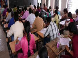 a group of people sitting at a table in front of a crowd: HP TET 2020: Admit card released at hpbose.org, exams to begin from 26 July
