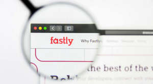 a close up of a screen: A magnifying glass zooms in on the Fastly (FSLY) website.