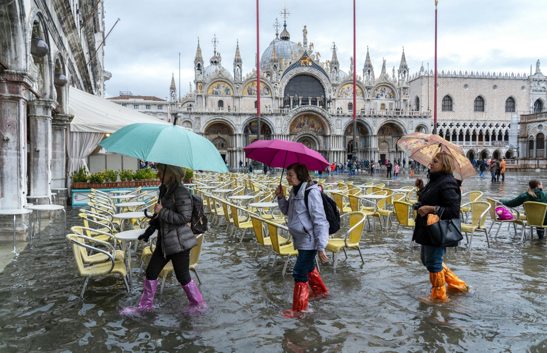 Slide 33 of 37: Most recently, in November2019, Venice experienced its worst flooding for over half a century, as water levels reached 6.1 feet (1.8m)at its peak, causing 80% of the city to flood. St Mark's Square (pictured) was off-limits, as residents and tourists waded through the streets,schools closed for a number of days and the government declared astate of emergency. High tides, worsened by sirocco winds blowing from Africa, caused damage to homes, monuments and killed two people.