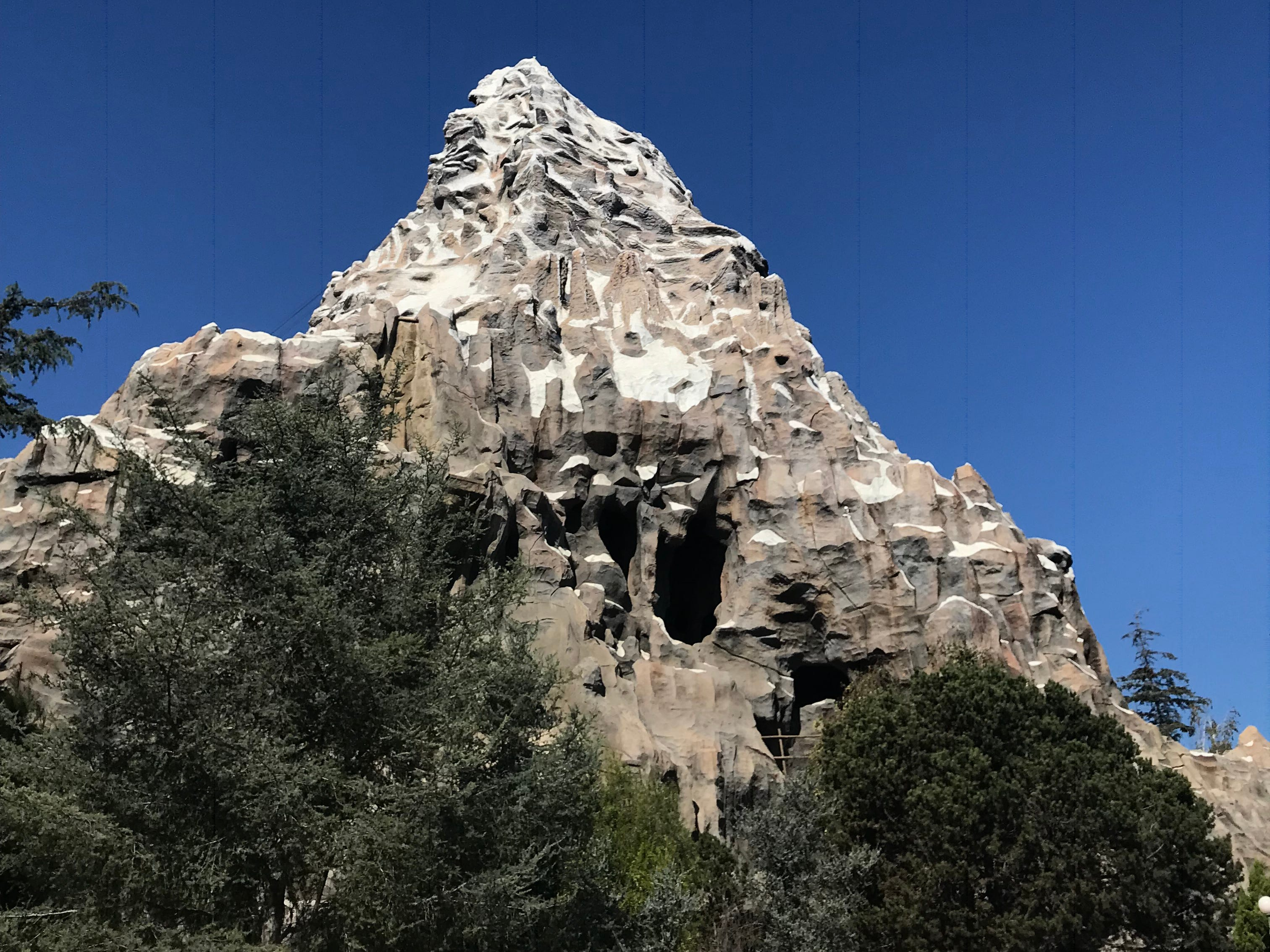 Slide 15 of 23: Since 1959, the Matterhorn has been the highest point inside Disneyland Park at 147 feet. The mountain was built to a one-100th scale of the actual Matterhorn Mountain, which stands at 14,700 feet.