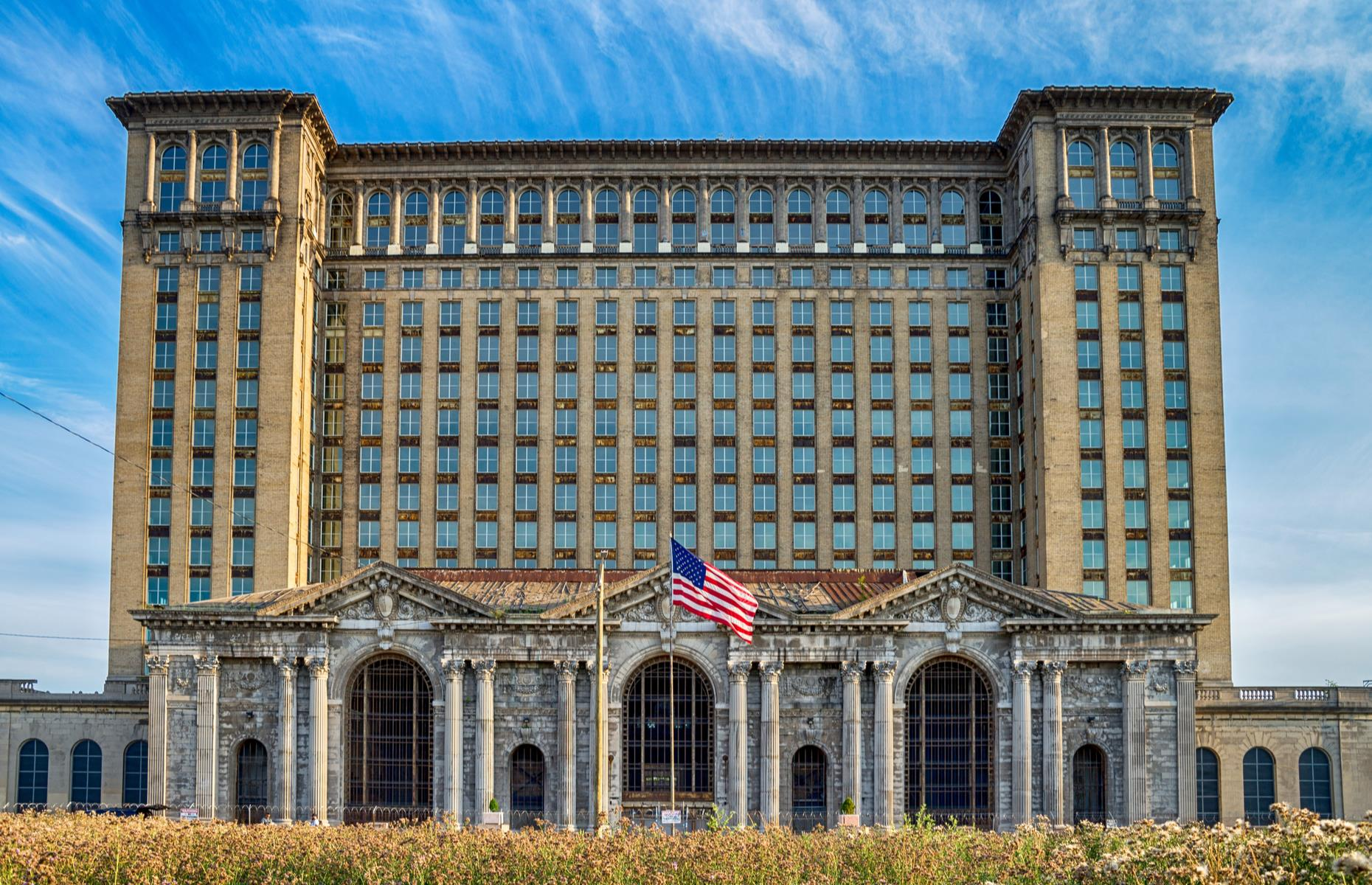Slide 2 of 33: Since it opened in 1913, this vast train station has towered over Detroit's historic Corktown neighborhood. But in more recent decades, it became a symbol of the city's decline. The former intercity passenger rail depot was built for the Michigan Central Railroad, but after Amtrak finally stopped using the station, it was closed in the late 1980s and left empty. However, hope has returned as the historic building has recently been bought by the Ford Motor Company.