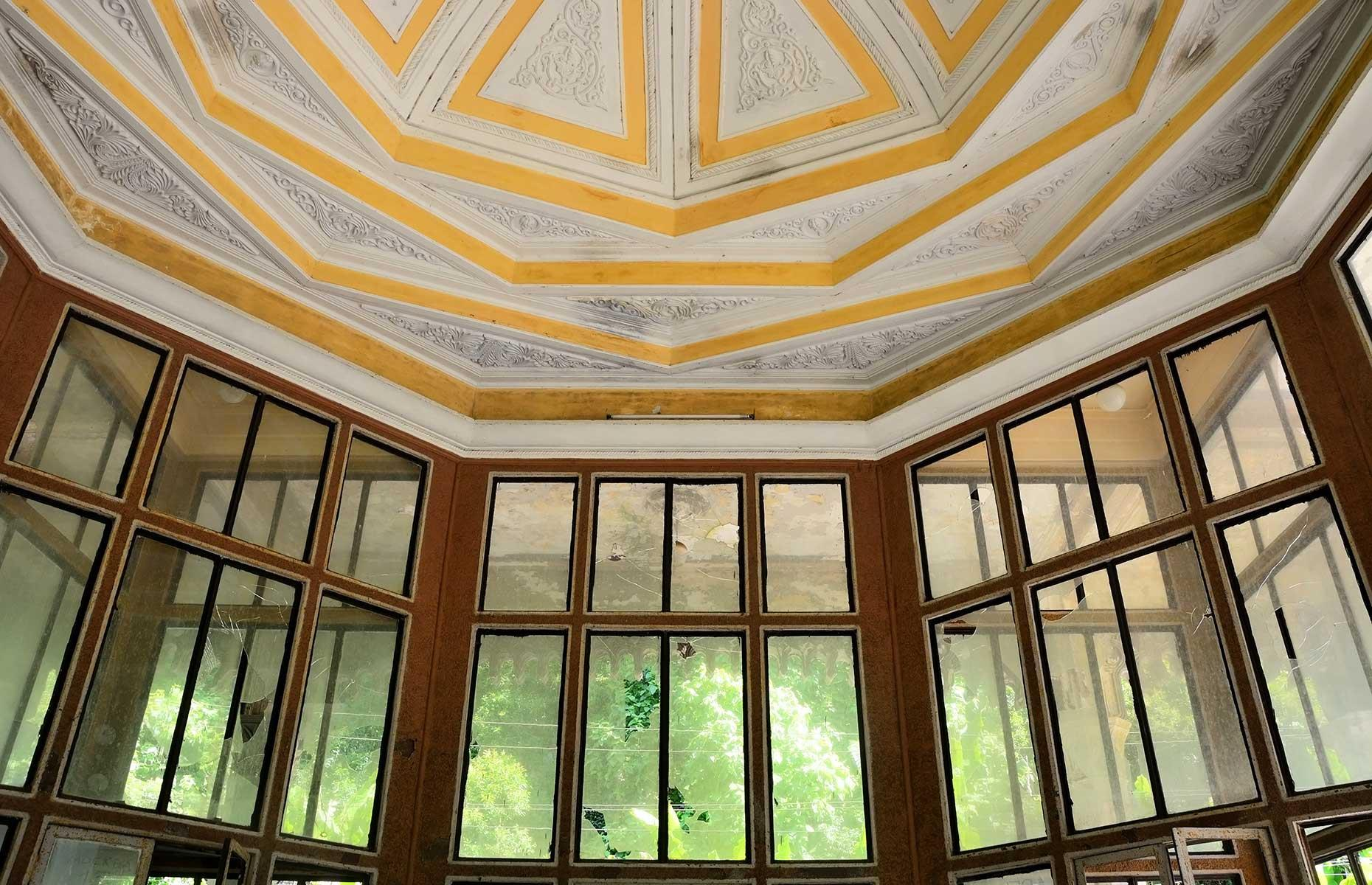 Slide 30 of 33: Inside some of the glass windows are broken and the wooden paneling has been damaged but the ceiling remains intact. Today, the station has become something of a magnet for photographers keen to picture the pavilion's unique shape.