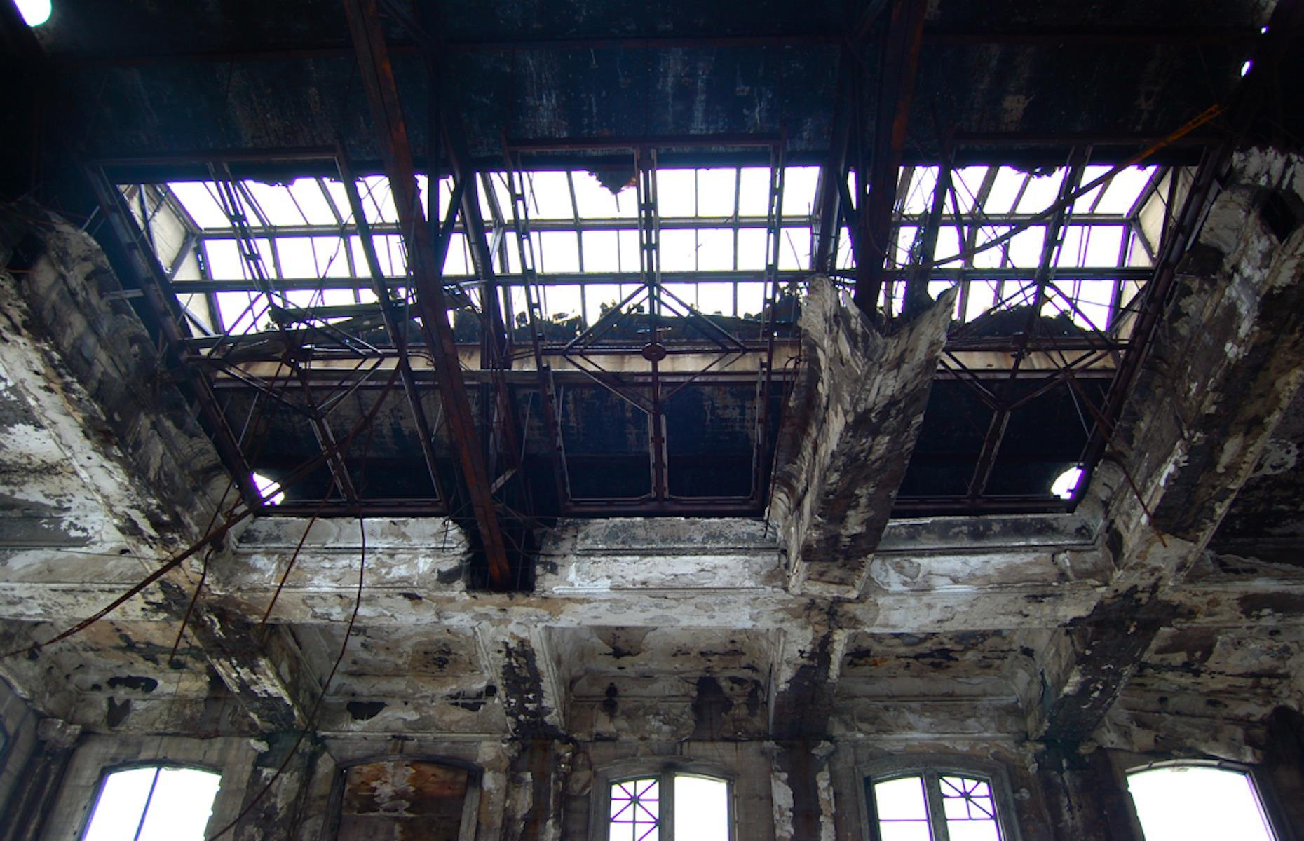 Slide 8 of 33: The exterior of the station remains amazingly intact, but the interior, including its once grand and cavernous hall, has been gutted and vandalized. Gary has several other notable ruins, including the City Methodist Church, each telling of the town's slump from a thriving center of industry.