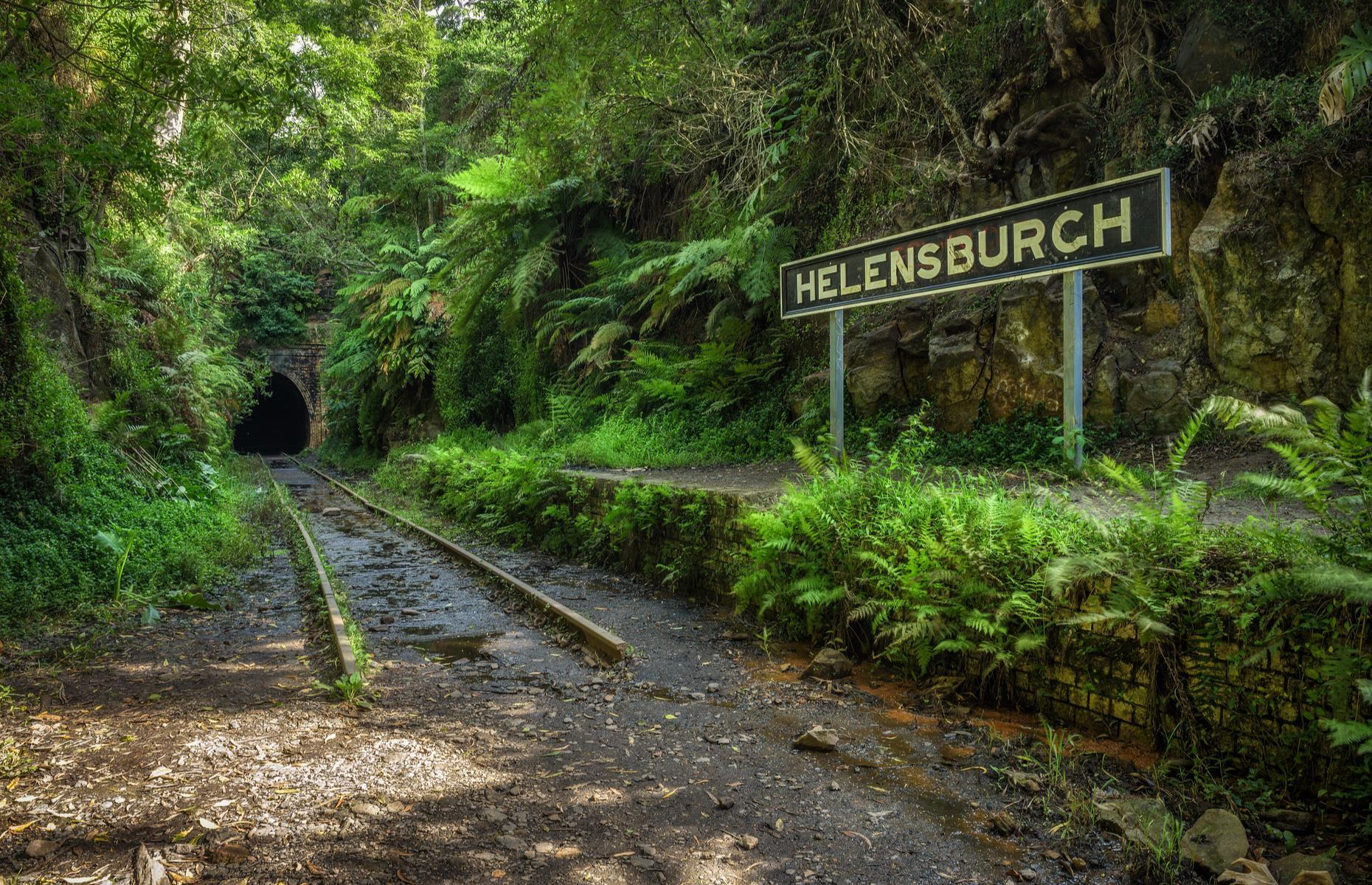 Slide 10 of 33: The Sutherland to Wollongong train line was built in New South Wales between 1884 and 1886 to service the coalfields and farms. There are seven abandoned tunnels between Waterfall and Otford, together known as the Helensburgh Tunnels, as well as the desolate Helensburgh station. The area is now popular with walkers, rail enthusiasts and ghost hunters, and there have even been reported sightings of a ghostly figure in the dark tunnels. It's said to be Robert Hails, a miner hit by a train in 1895.