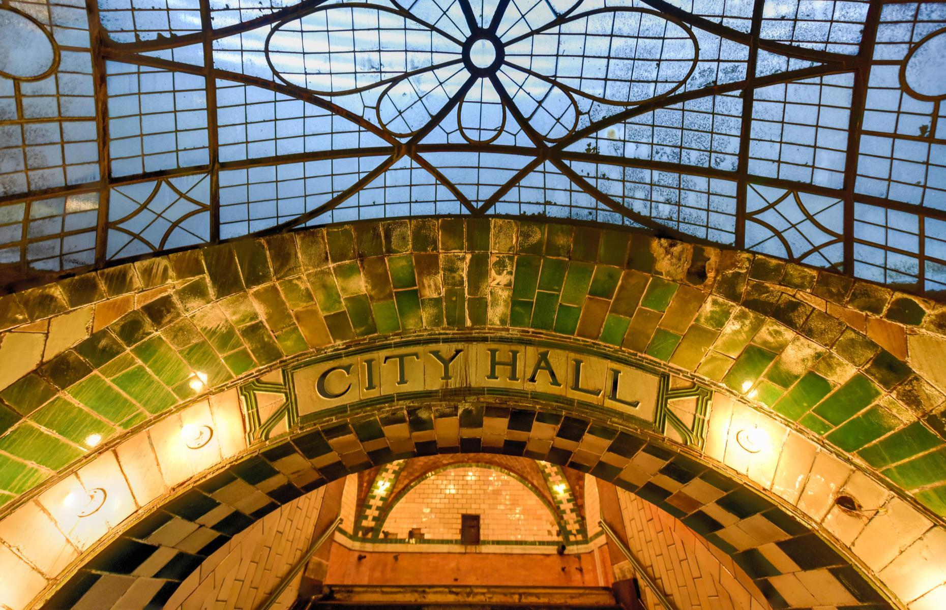 "Slide 25 of 33: Built in 1904 by renowned architects Heins & LaFarge, City Hall was the very first subway station that opened to the public in New York City. Services were discontinued in 1945 as passengers found the nearby Brooklyn Bridge station, which had access to both express and local tracks, more convenient. The city's ""lost"" station is an incredible space that remains remarkably well preserved."