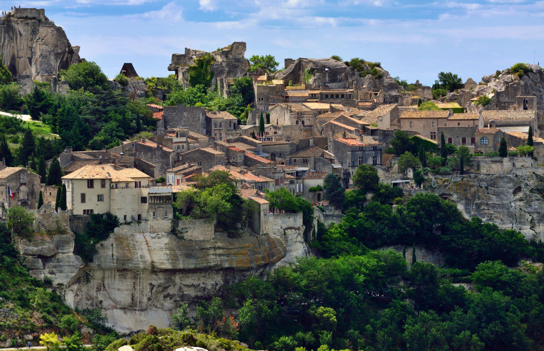 Slide 15 of 37: Perched on a 3,000–foot (900m) rocky formation of the Alpilles hills in Provence, Les Baux-de-Provence towers above the Crau and the Camargue regions like a beacon. At the top of the rugged escarpment, the ruins of its namesake medieval citadel dominate the nearby olive groves, vineyards and the La Fountaine valley. Beneath its looming fortress, Renaissance houses decorate its centerwhilehoteliers, restaurateurs, oil and wine producers and artists have given the lovely village a new lease of life. Love small towns? These are Canada's finest too.