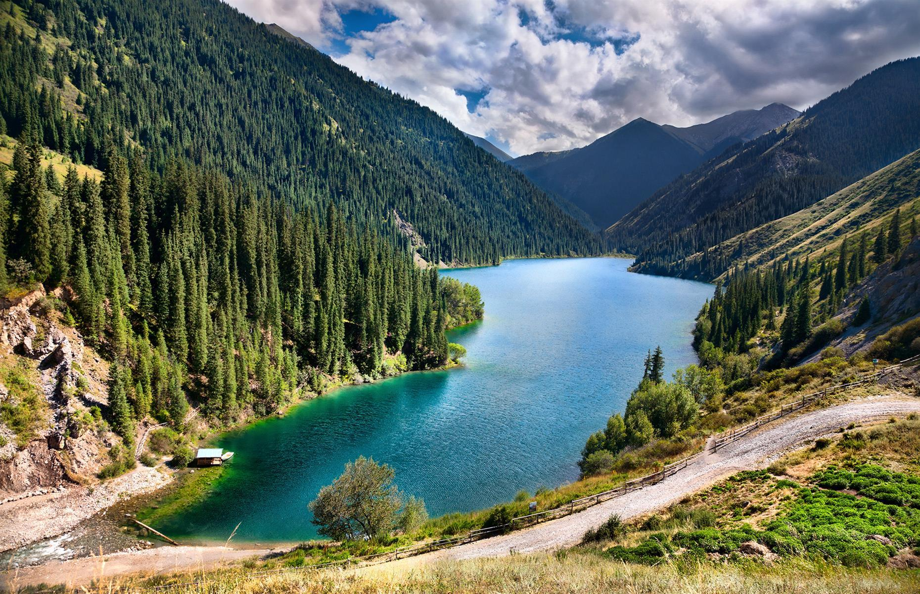 "Slide 41 of 44: Spreading out close to the Kyrgyzstan border, the wilderness here is characterized by glassy lakes, green peaks and pastures, with rivers running through thick, untouched forest. It's little wonder that the Kolsai Lakes are often dubbed the ""Pearls of Tien Shan""."