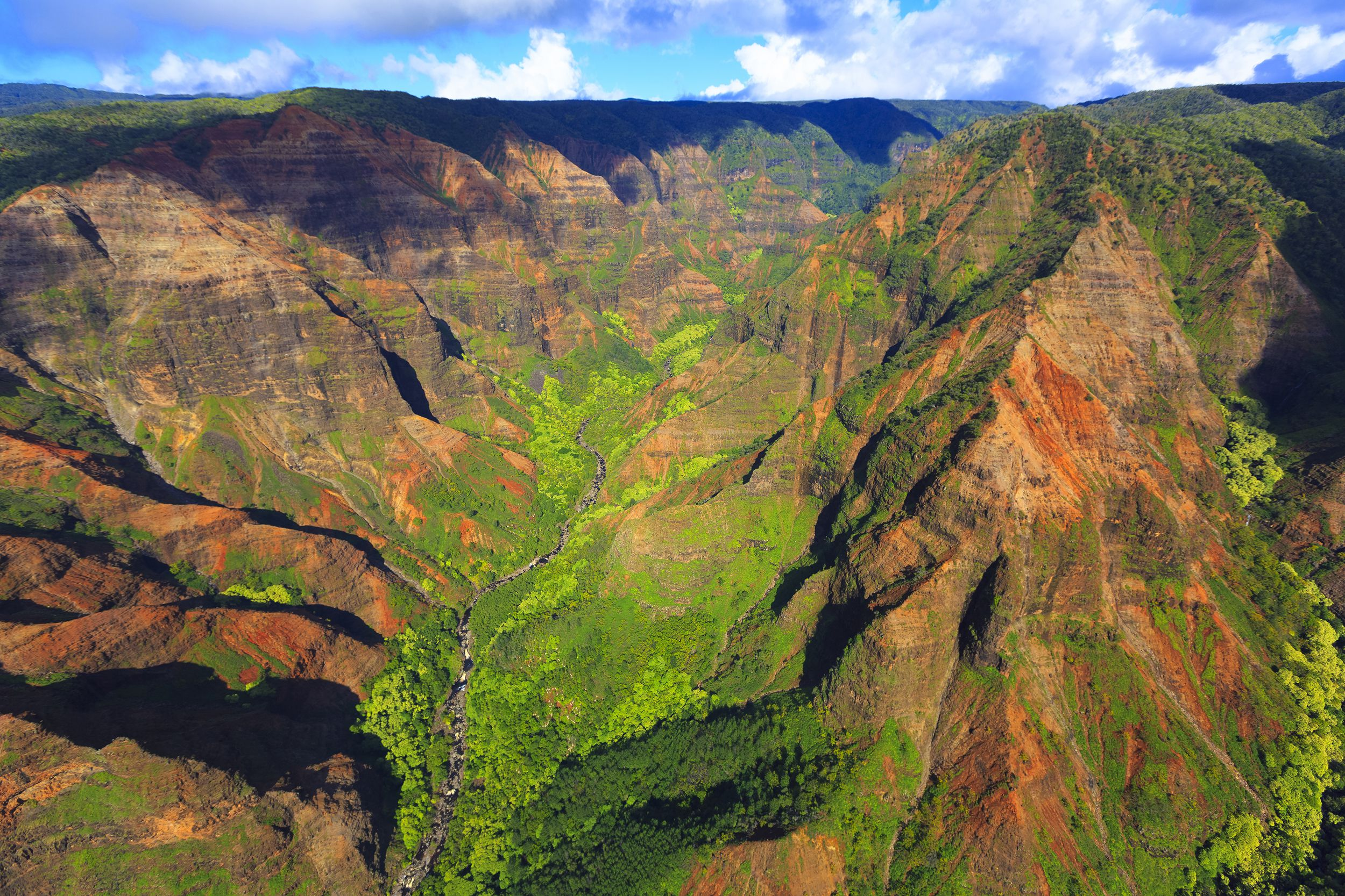 "Slide 12 of 52:  Where: Waimea Canyon State Park Distance: 3.2 miles out and back Must see: Observe the ""Grand Canyon of Hawaii,"" a majestic canyon on Hawaii's Westernmost island."
