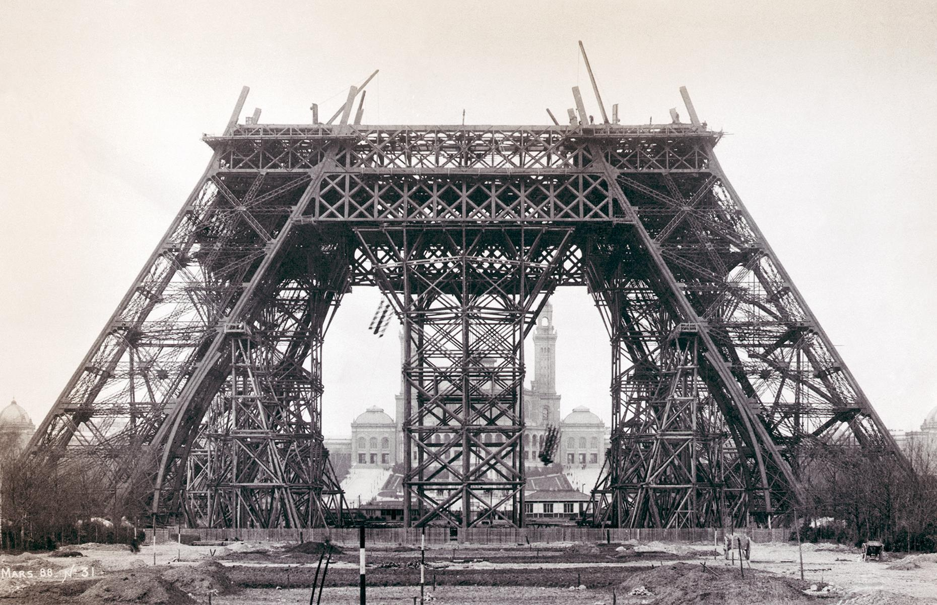 Slide 6 of 32: It's hard to imagine the Paris skyline without the Eiffel Tower, but the landmark was originally intended to be a temporary installation. It was built for the International Exposition of 1889, serving as the impressive gateway to the show, with the tower itself soaring to 984 feet (300m). It was due to be pulled down in 1909 which would have given it a 20-year lifespan.