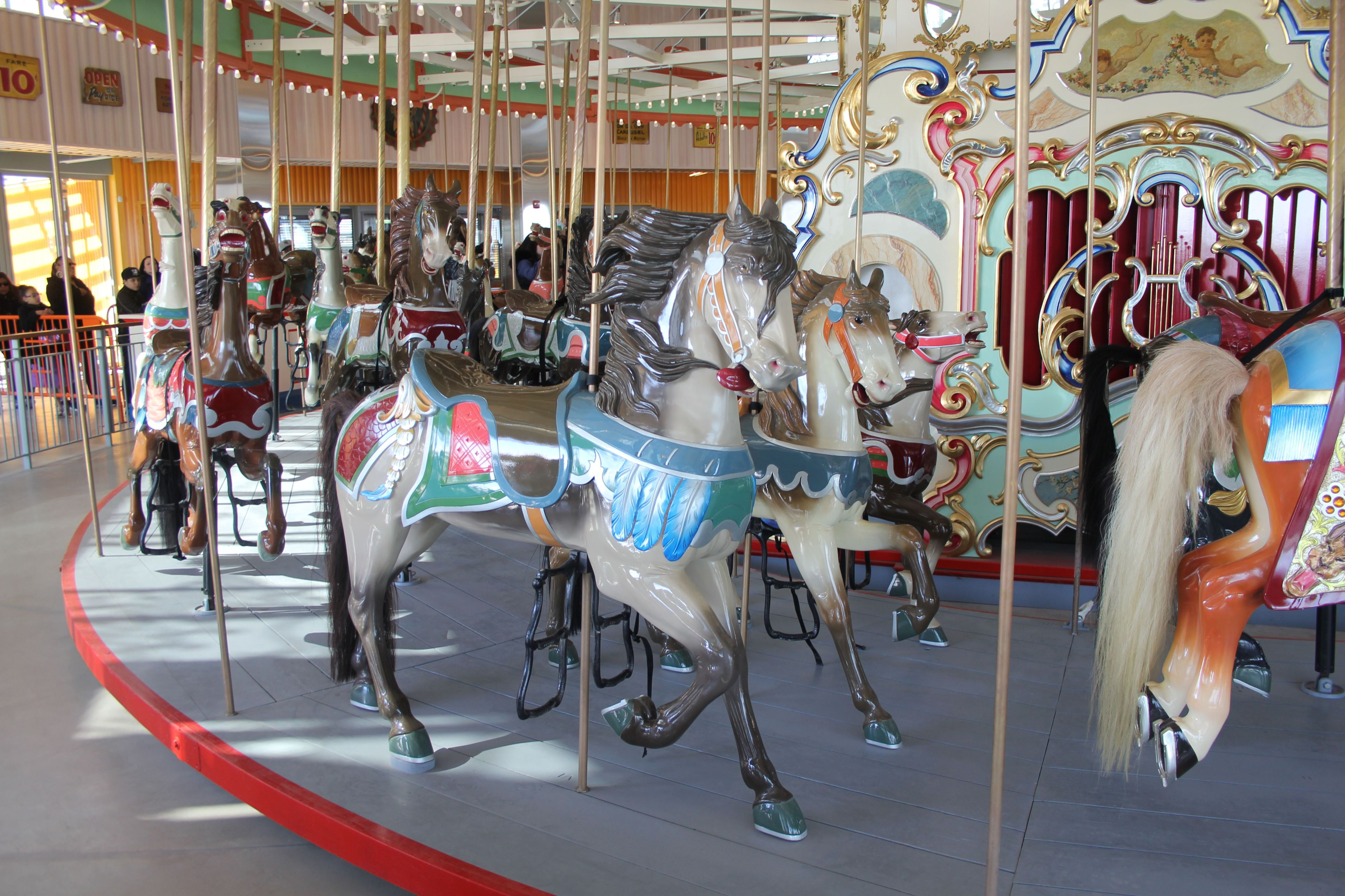 "Slide 14 of 15: Coney Island's ""last traditional carousel"" from the early 20th century has more than 50 hand-carved wooden horses and two chariots. It also was spruced up as part of the restoration project."