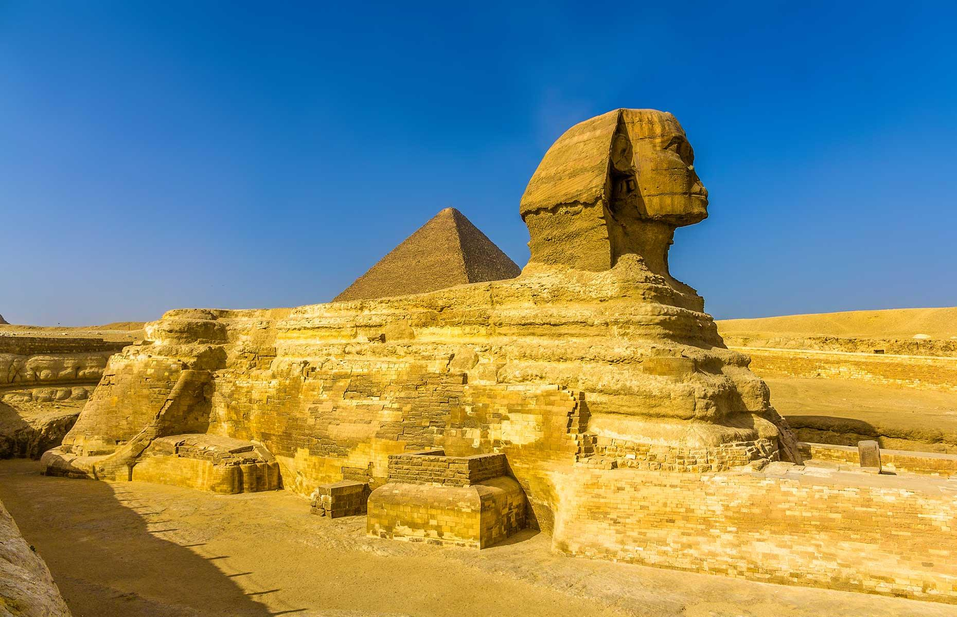 Slide 4 of 14: The Great Sphinx was also built for Khaefre. Carved from a rock outcrop, the landmark is generally accepted to be a representation of the king with a lion's body. It measures 240 feet (73m) from paw to tail, rises 65 feet (20m) high and is about 62 feet (19m) wide across the haunches. The lower part of the sphinx is composed of softer limestone than the head – this led to a greater degree of erosion, which was repaired first in antiquity.