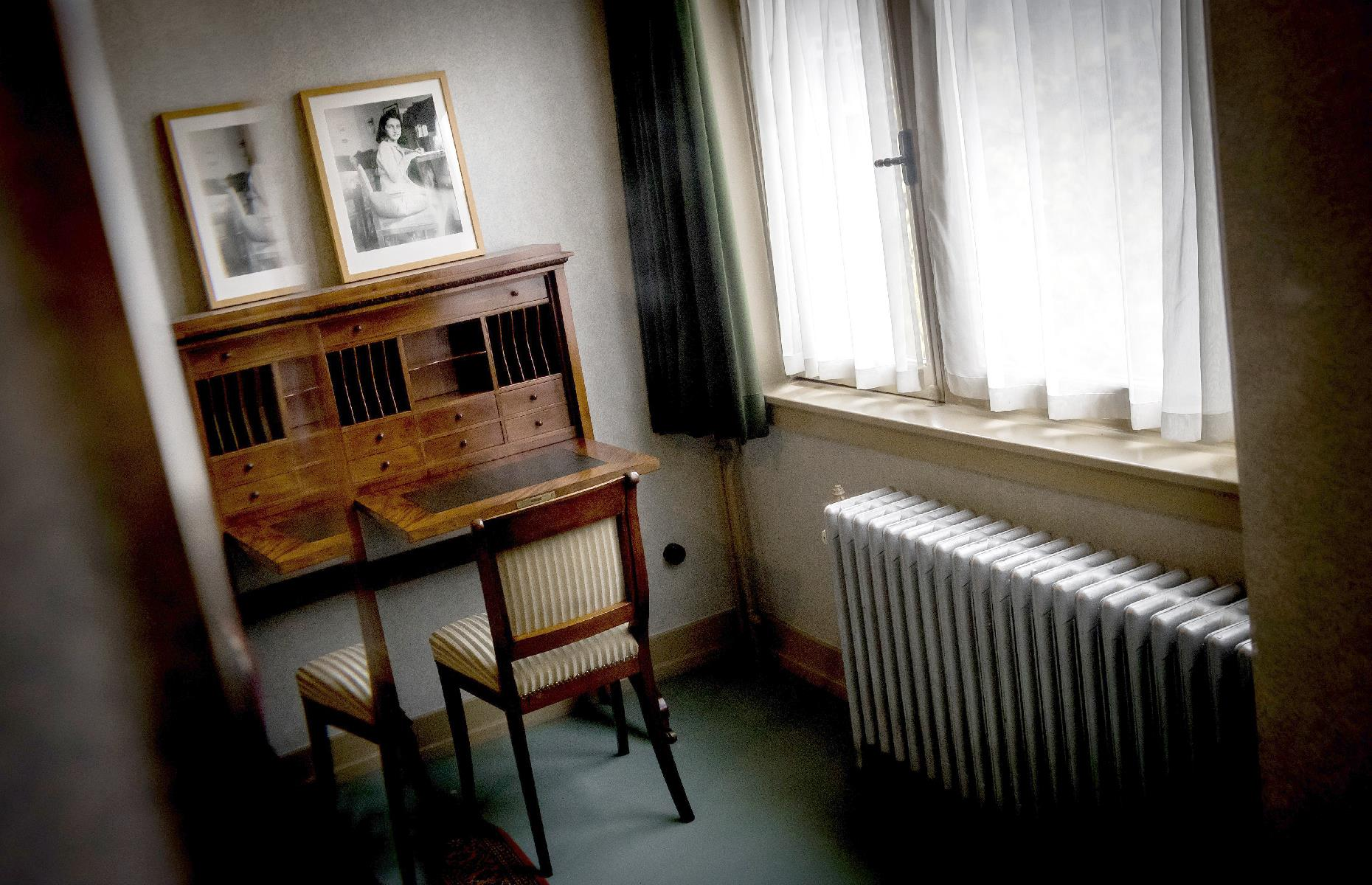 Slide 21 of 32: This unassuming canal-side house in Amsterdam was made famous by Anne Frank, a young Jewish girl who hid in a secret annex with her family during the Nazi regime and kept a diary of her experiences. Although Anne didn't survive the war, her diary was preserved and later published. This 2017 shot shows the room she occupied as preserved by the Anne Frank Foundation.