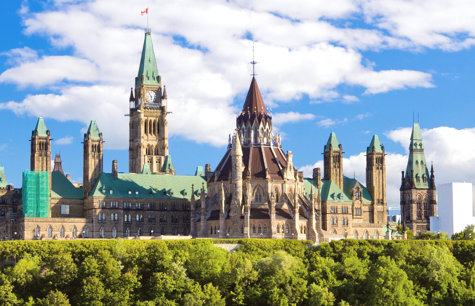 Slide 11 of 32: Against the odds, the Library of Parliament was saved as its mighty iron doors were closed. The other buildings were completed again by 1927 and today they still brood over Canada's capital. The Library of Parliament remains the site's crowning jewel.