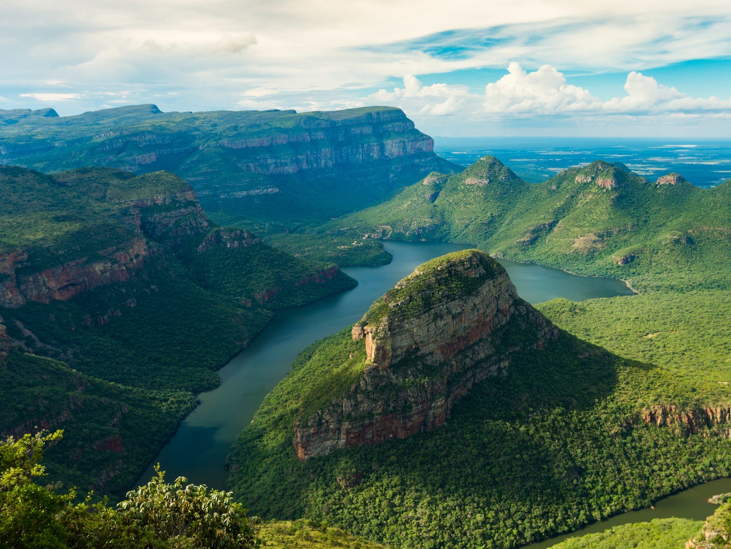 Slide 50 of 51: For gorgeous natural views, go for a hike along the Blyde River Canyon, which sits at an elevation of more than 2,600 feet. This canyon, known for its unique geology — including the Pinnacle, a looming quartzite column — also boasts diverse flora and fauna.