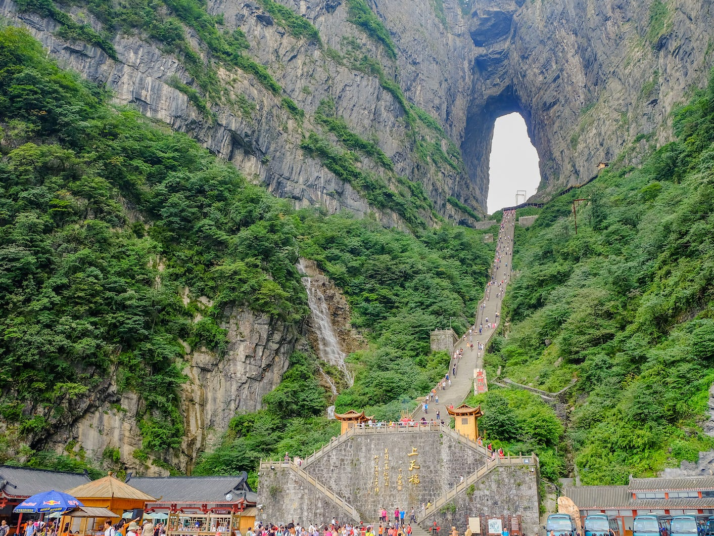 """Slide 48 of 51: Situated 5,000 feet above sea level, Tianmen Cave is one of the highest naturally formed arches on the planet. Visitors have to mount a 999-step """"stairway to heaven"""" to reach the site."""