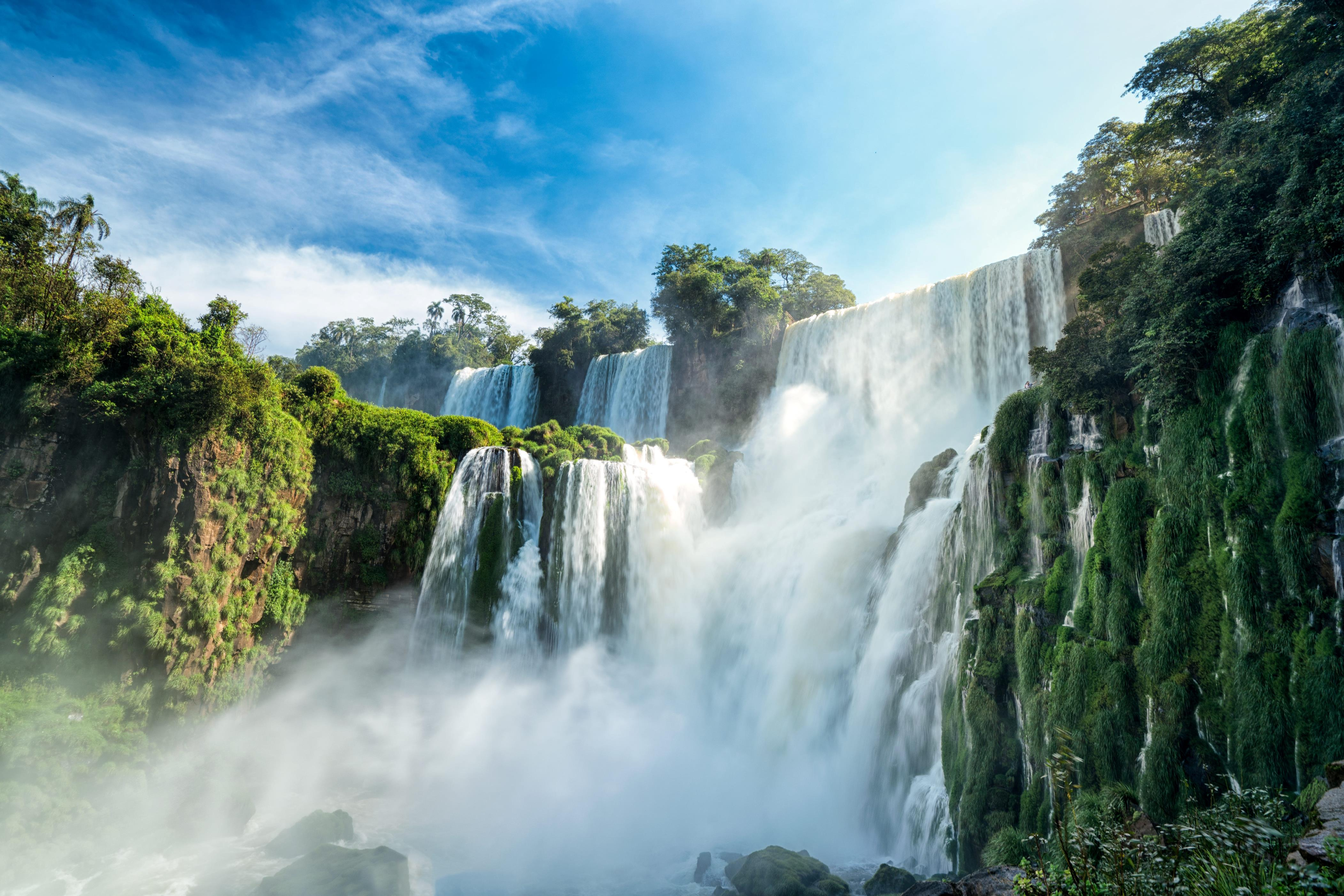 Slide 47 of 51: Spanning Argentina and Brazil, the Iguazu Falls are part of a massive waterfall system thattotals around 275 waterfalls.