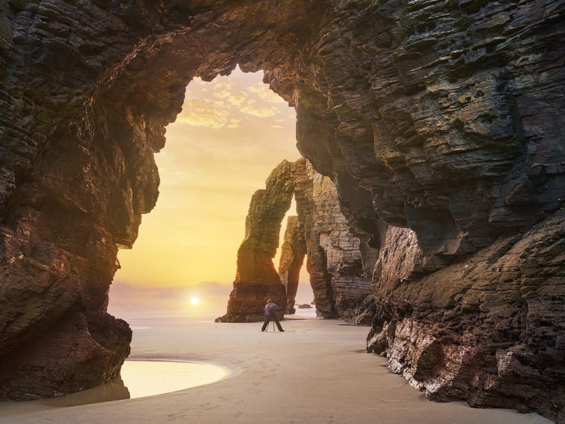 Slide 42 of 51: You'll do a double take when you see the rocky arches at the Beach of the Cathedrals: these incredible buttress-like formations were shaped solely by nature.