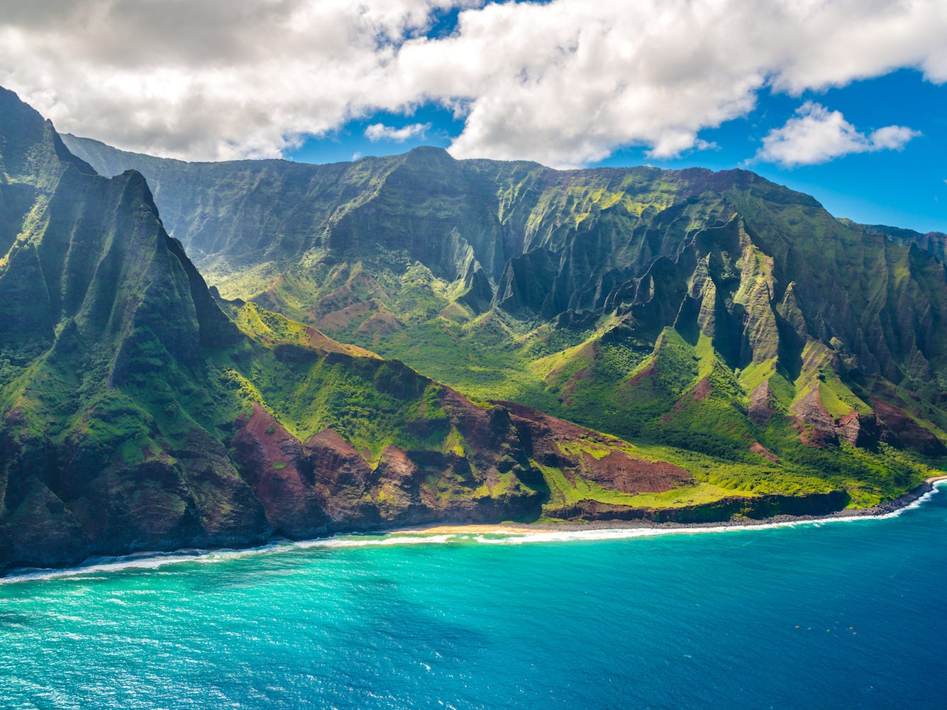 Slide 34 of 51: Between the colorful cliffs and the azure blue waters below, Hawaii's Na Pali Coast is sure to wow any visitor. Hiking the cliffs will afford you 4,000-foot-high views of the Pacific Ocean andKalalau Valley, as well as plenty of beautiful waterfalls along the way.