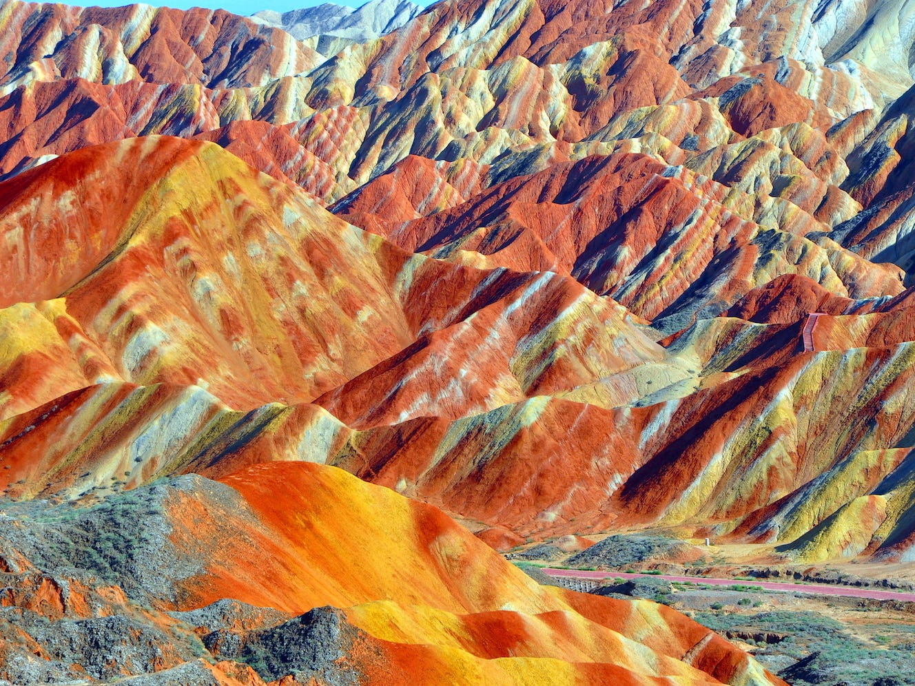 Slide 22 of 51: Danxia refers to a special type of landscape found in southwestern China. The colorful, striped mountains are made up of layers of minerals and rock, which were disrupted when tectonic plates caused the island that is nowIndia to collide with the rest of the Eurasiacontinent.Now a protectedUNESCO World Heritage Site, the once little-known wonder is a popular tourist draw — and for good reason. Chances are you've never seen anything like it before.
