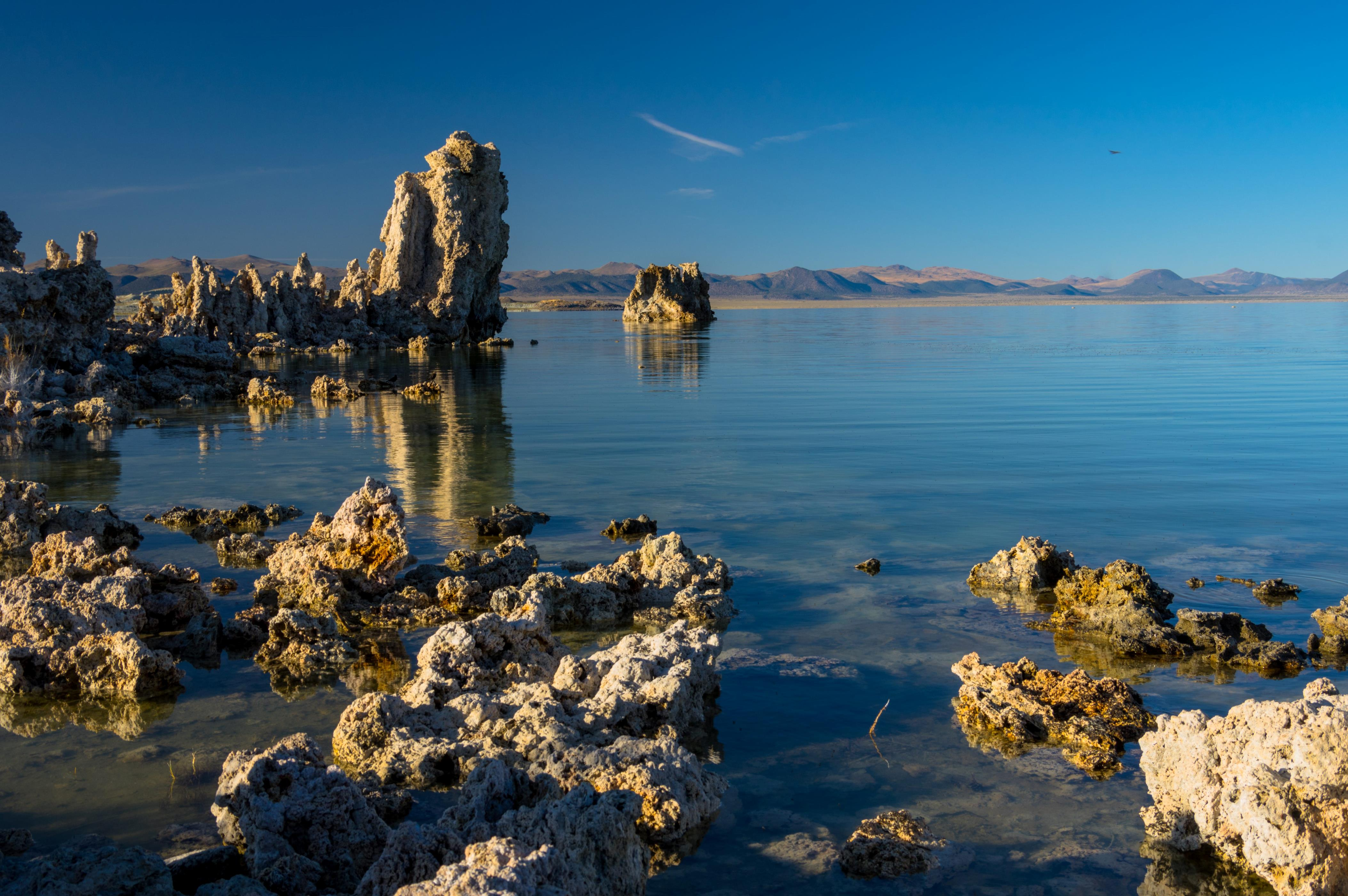 Slide 38 of 51: Mono Lake, which spans 65 square miles, is known for eye-catching, calcium-carbonite structures known as tufa towers. With a high salt content, this ethereal lake is also extremely buoyant.