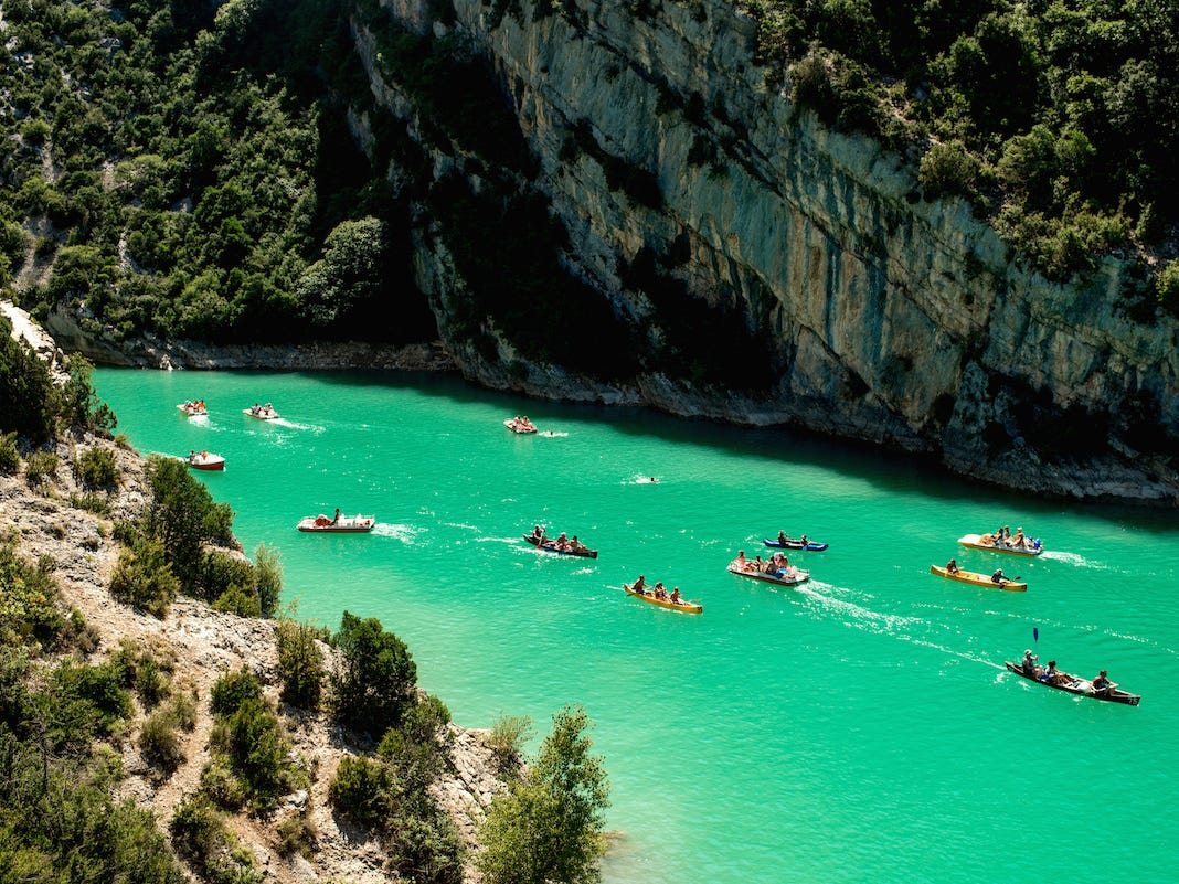 Slide 30 of 51: The Verdon Gorge's blue-green waters are a picturesque setting for activities ranging from swimming to kayaking.