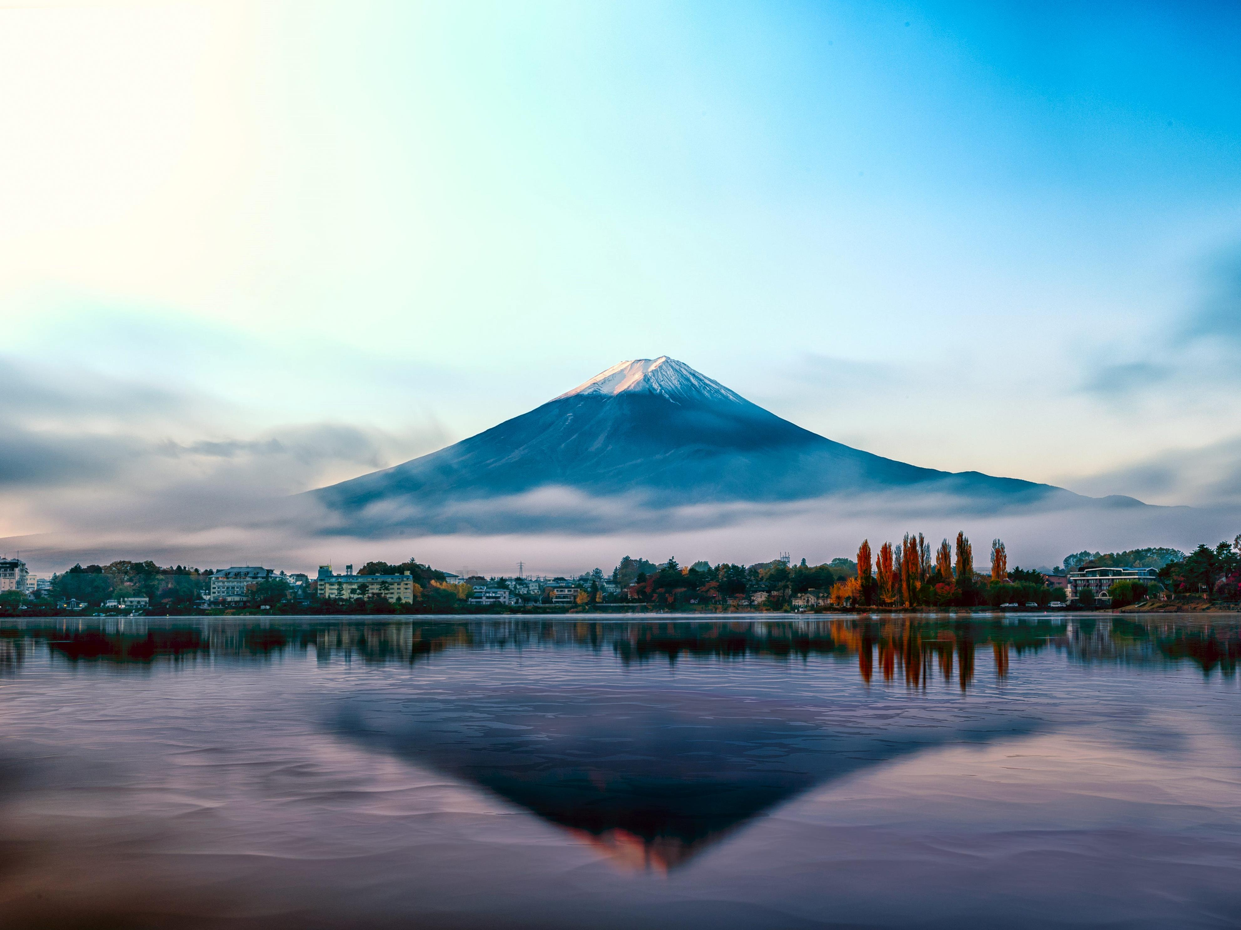 Slide 18 of 51: Japan's tallest mountain (12,388 feet high) towers over the nearby countryside, which is often enveloped in a thick layer of fog. Fuji is an active volcano, last erupting in 1707.