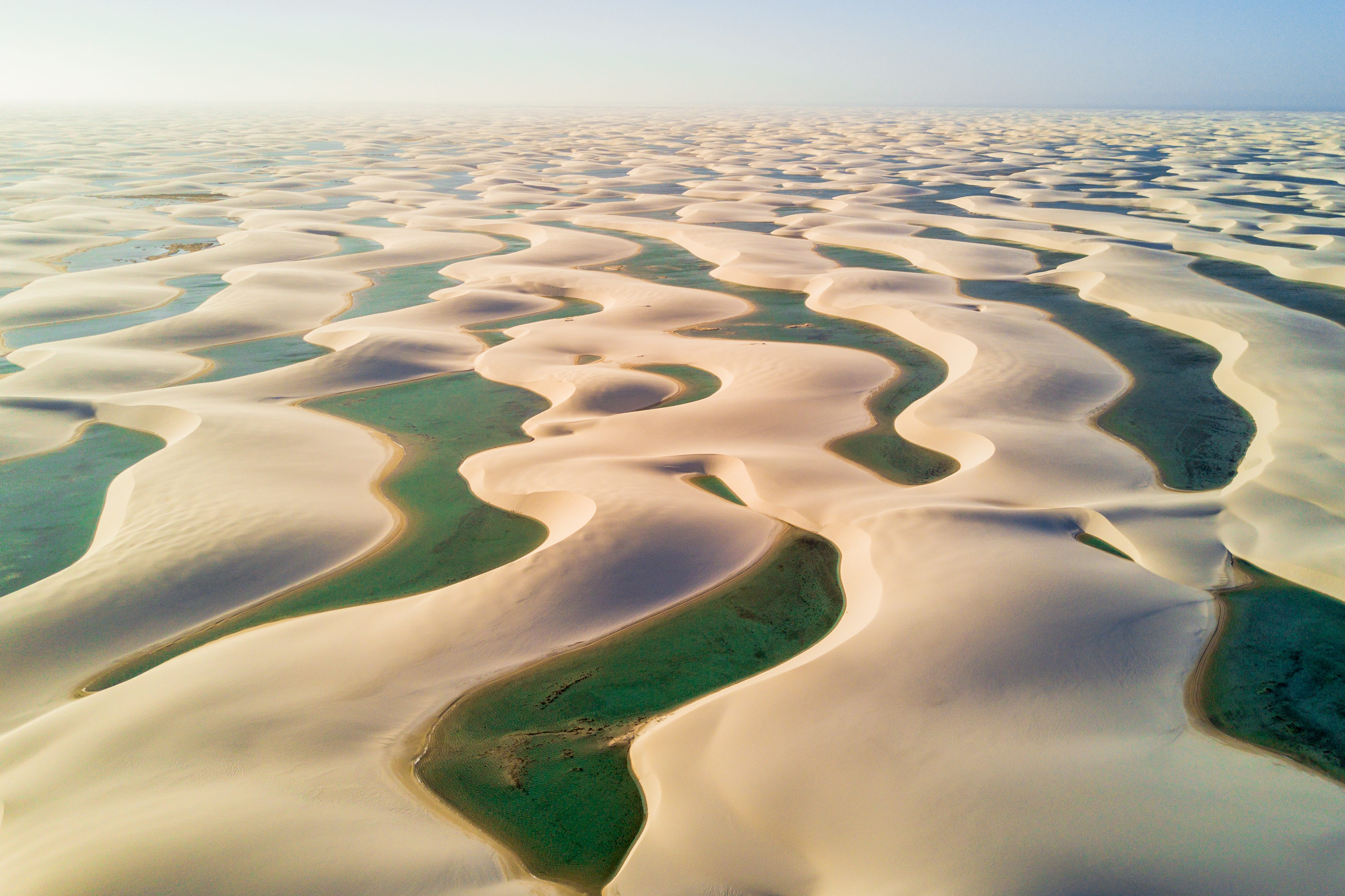 Slide 20 of 51: The blinding white sand dunes are inter-cut with rivers, pushing the thousands of tons of sand out into the Atlantic Ocean.